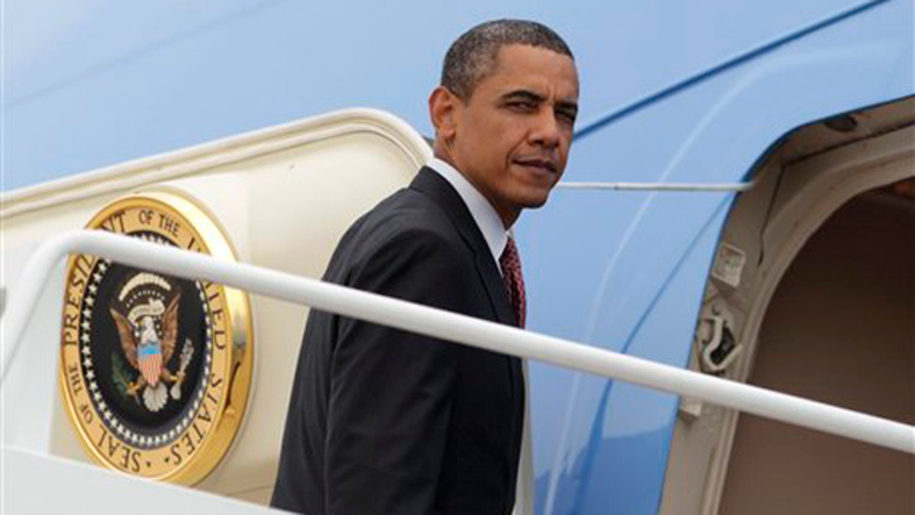 President Obama boards Air Force One at Andrews Air Force Base, Md., June 23 en route to New York.