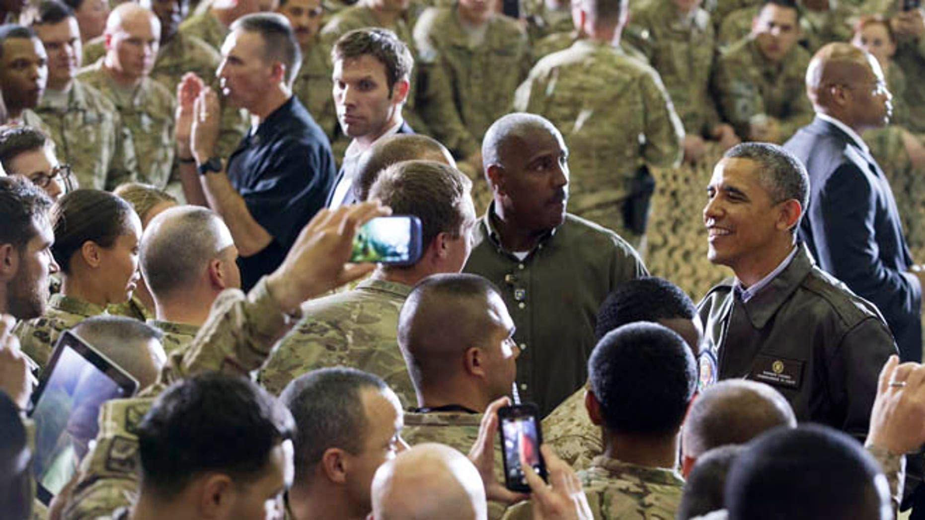 May 25, 2014: President Obama greets troops at Bagram Airfield, north of Kabul, Afghanistan, during an unannounced visit.