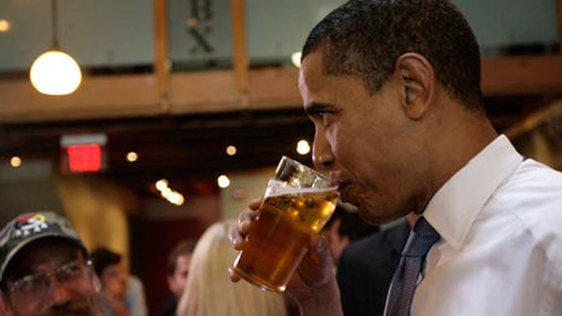 FILE: President Obama, who takes a sip of beer at  2011 event, is the first president to brew beer in the White House.