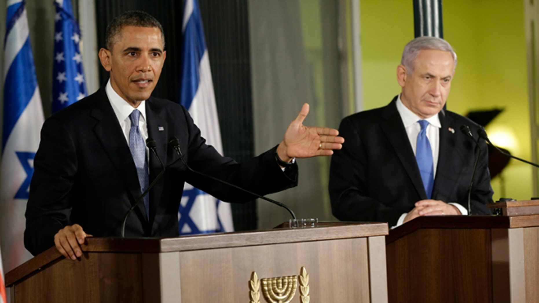 March 20, 2013: President Obama, accompanied by Israeli Prime Minister Benjamin Netanyahu, gestures as he speaks during their joint news conference in Jerusalem, Israel.