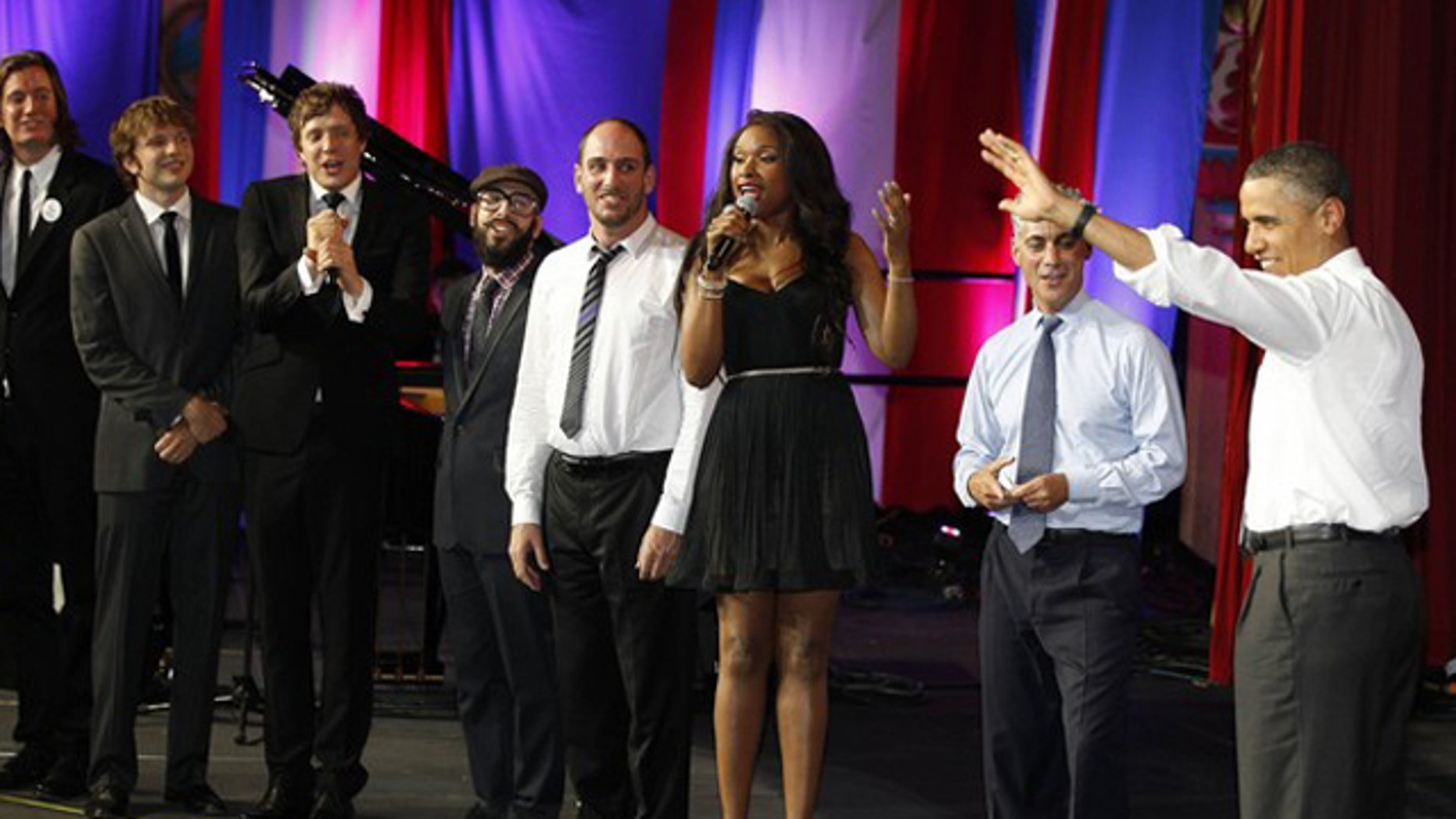 Aug. 3: U.S. President Barack Obama listens as performers, including Jennifer Hudson, sing 'Happy Birthday' to him to celebrate his 50th birthday before he delivers remarks at a Democratic National Committee fundraiser at the Aragon Entertainment Center in Chicago.