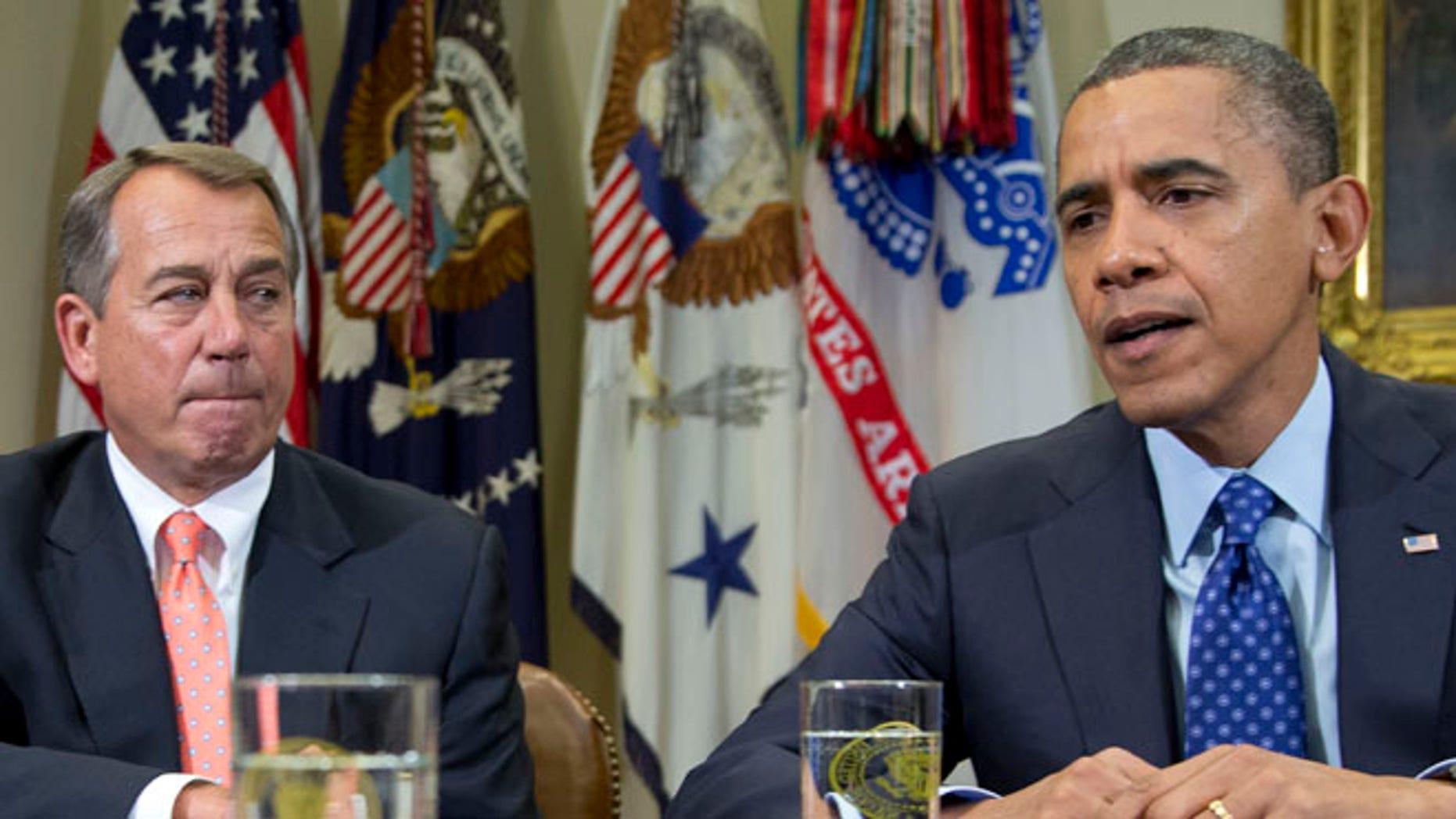 Nov. 16, 2012: President Obama, accompanied by House Speaker John Boehner, speaks to reporters in the Roosevelt Room of the White House.