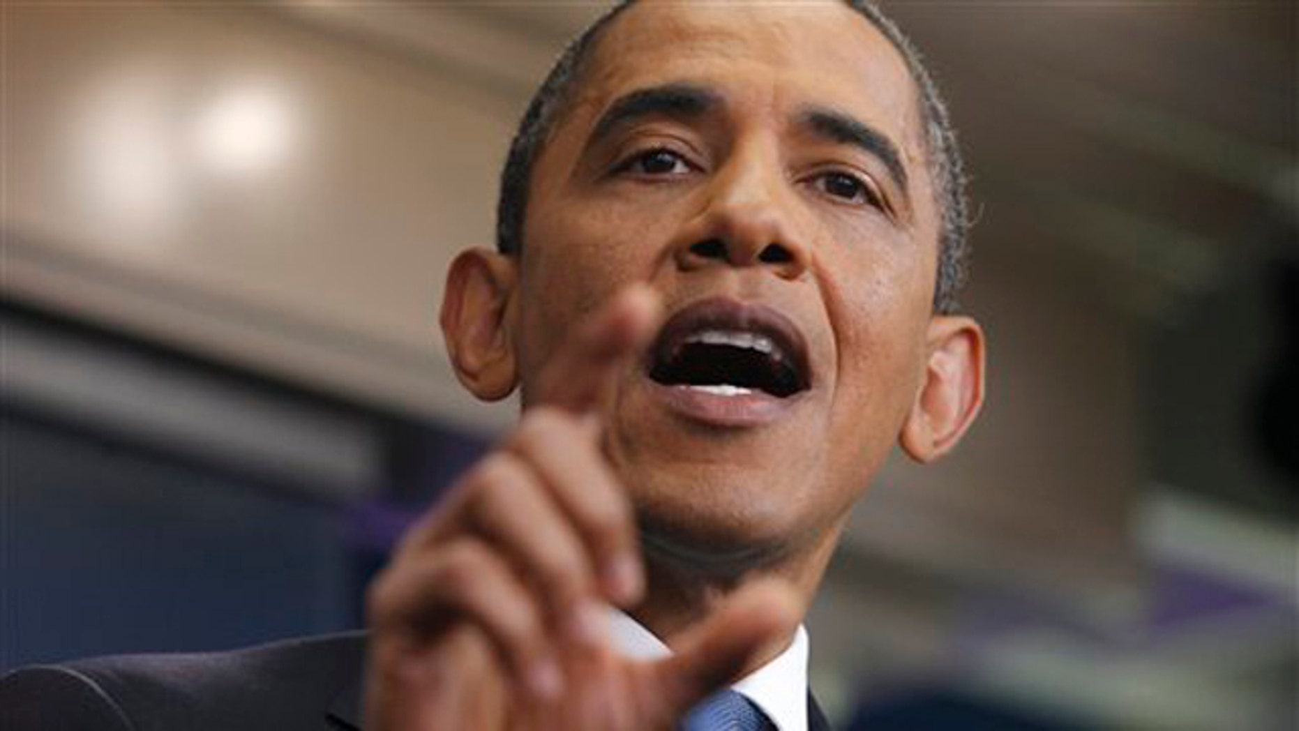 President Obama gestures during a news conference in the James Brady Press Briefing Room of the White House July 11.