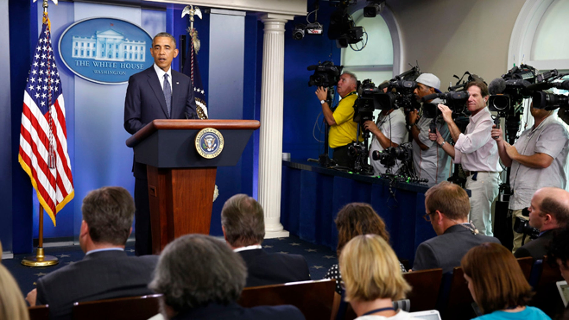 July 16, 2014: President Obama talks in the press briefing room at the White House.
