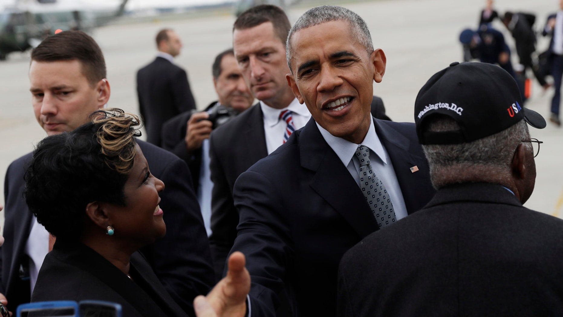 Sept. 28, 2016: President Barack Obama greets people on the tarmac as he arrives on Air Force One at Richmond International Airport, in Richmond, Va.