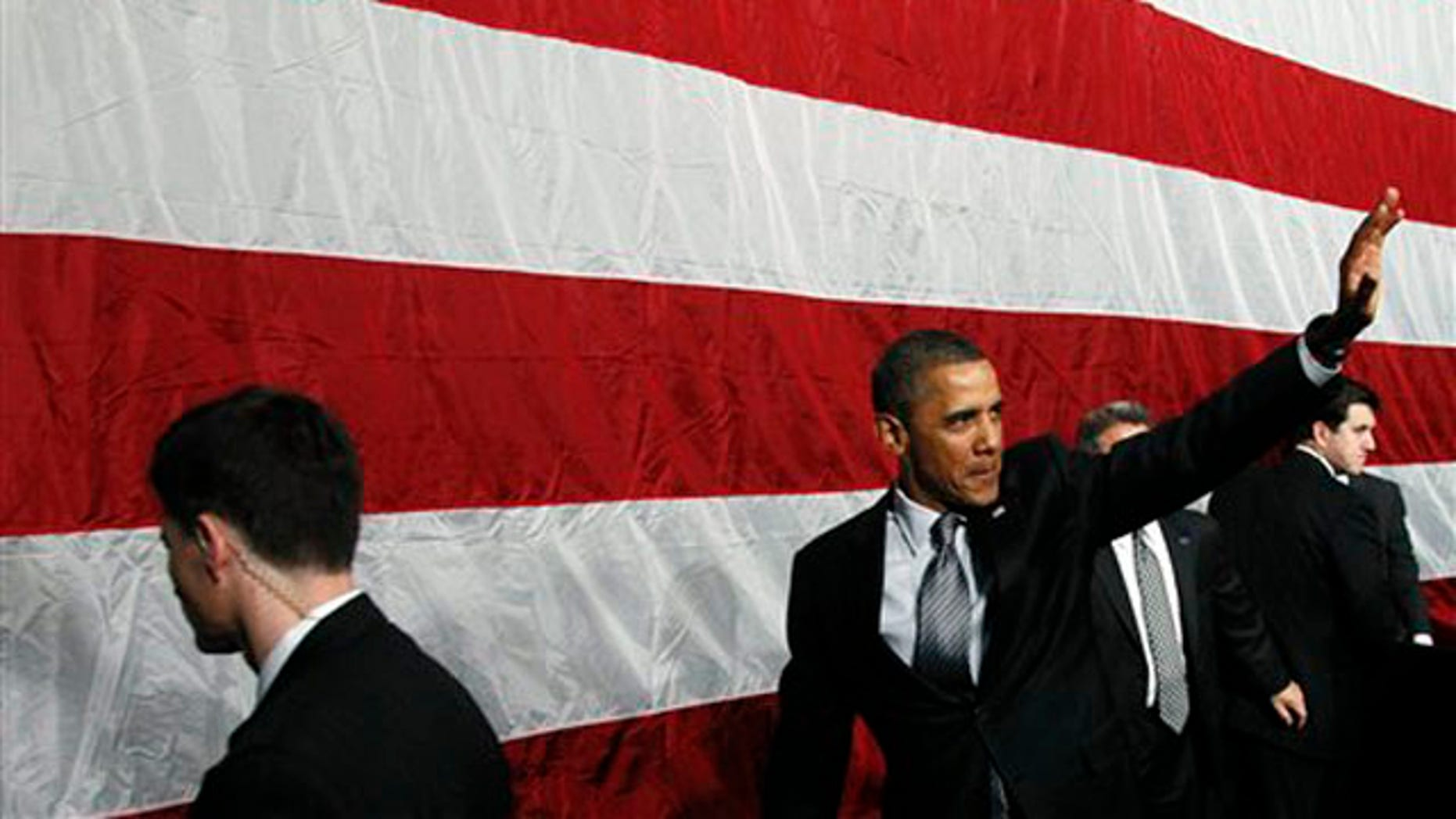Jan. 11, 2012: President Obama waves after he spoke at a campaign event at the University of Illinois in Chicago.