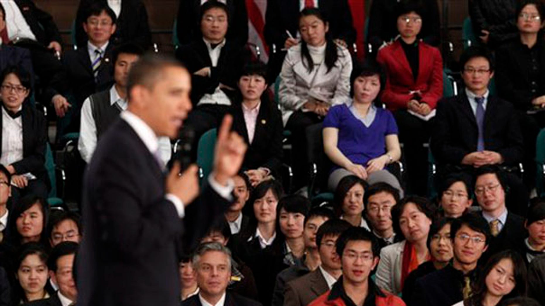 Monday: President Obama speaks at a town hall style event with Chinese youth at the Museum of Science and Technology in Shanghai, China. (AP Photo)