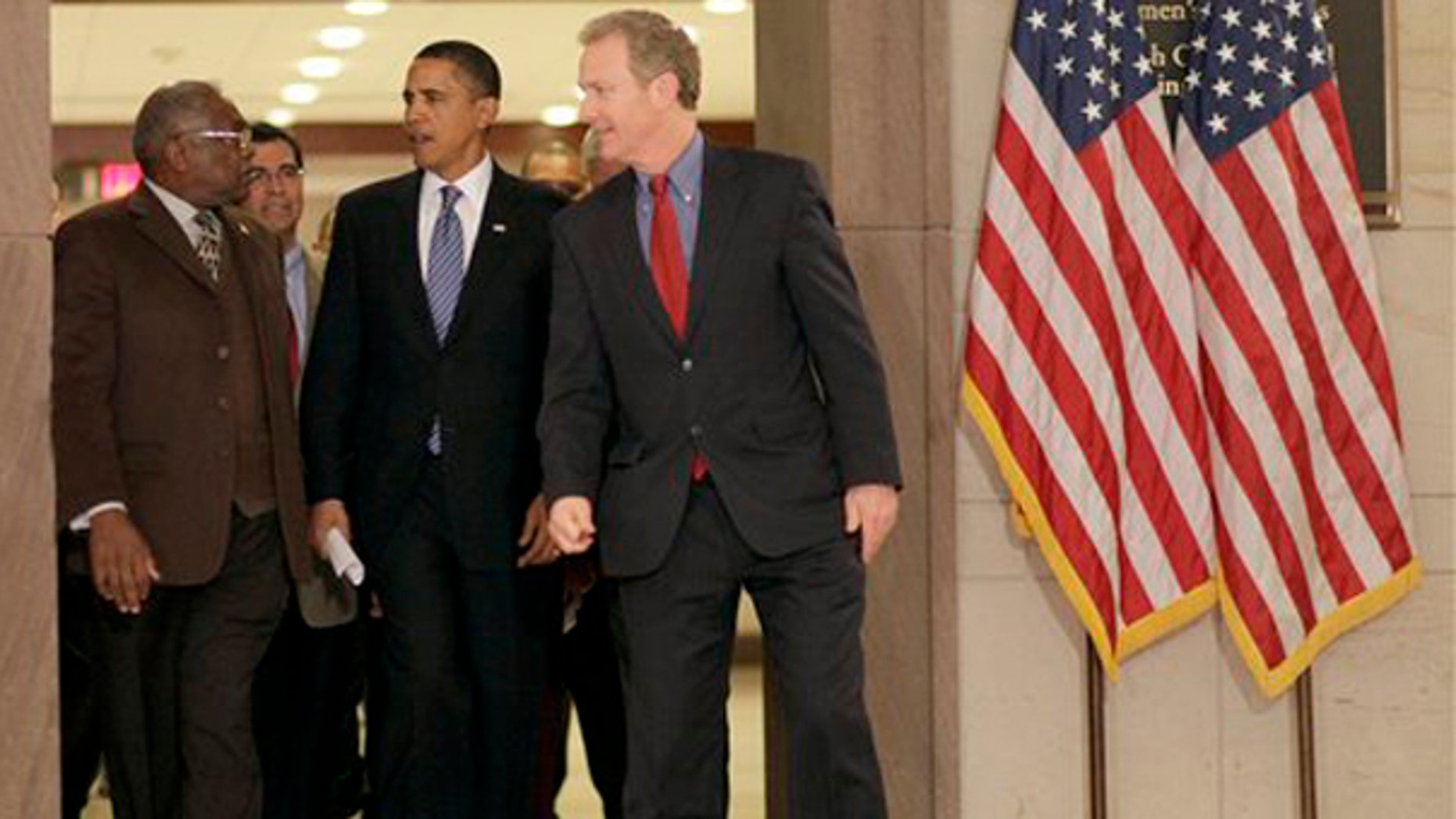 President Obama walks in with Rep. James Clyburn, Rep. Xaiver Becerra, and Rep. Chris Van Hollen as he prepares to speak at the House Democratic Leadership caucus retreat, Thursday, Jan. 14, 2010. (AP)