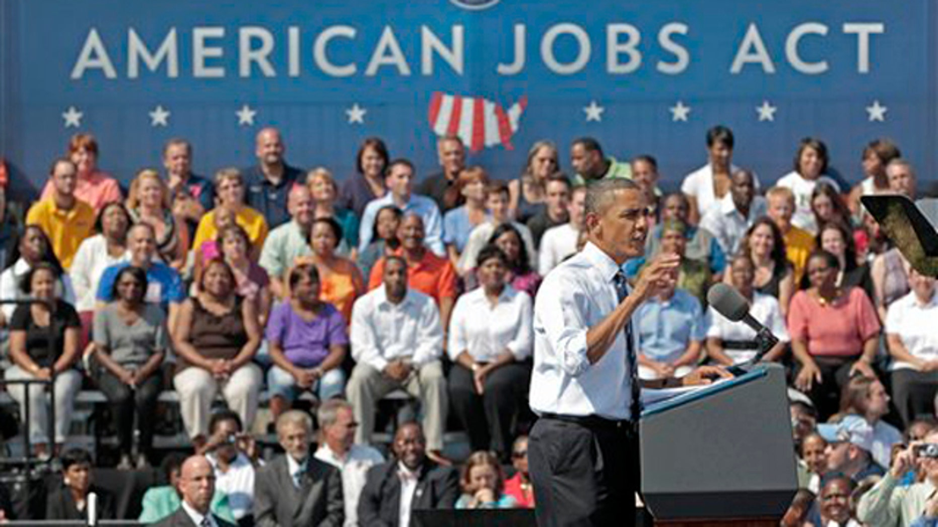 President Obama gestures as he speaks at Fort Hayes Arts and Academic High School in Columbus, Ohio, Sept. 13.