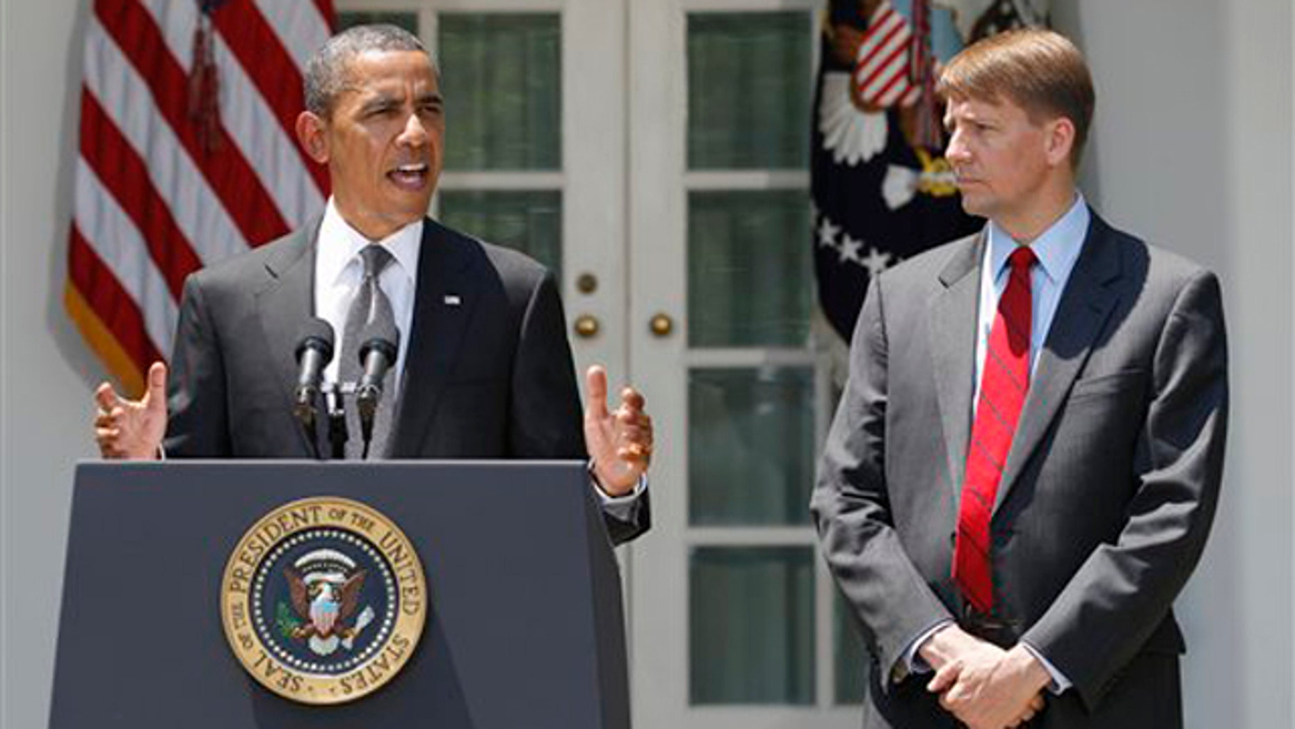 President Obama announces the nomination of former Ohio Attorney General Richard Cordray, right, to serve as the first director of the Consumer Financial Protection Bureau July 18 in Washington.