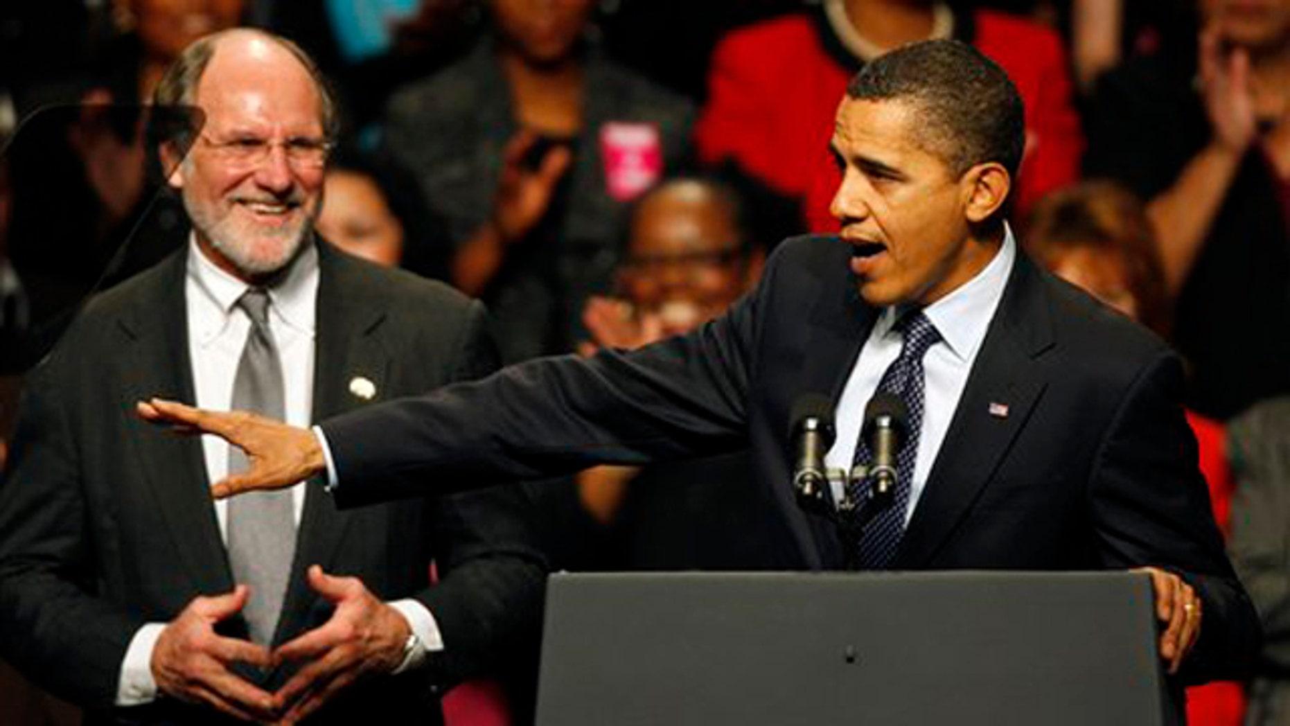 Gov. Jon Corzine listens to President Obama at a campaign rally Nov. 1 in Camden, N.J. (AP Photo)