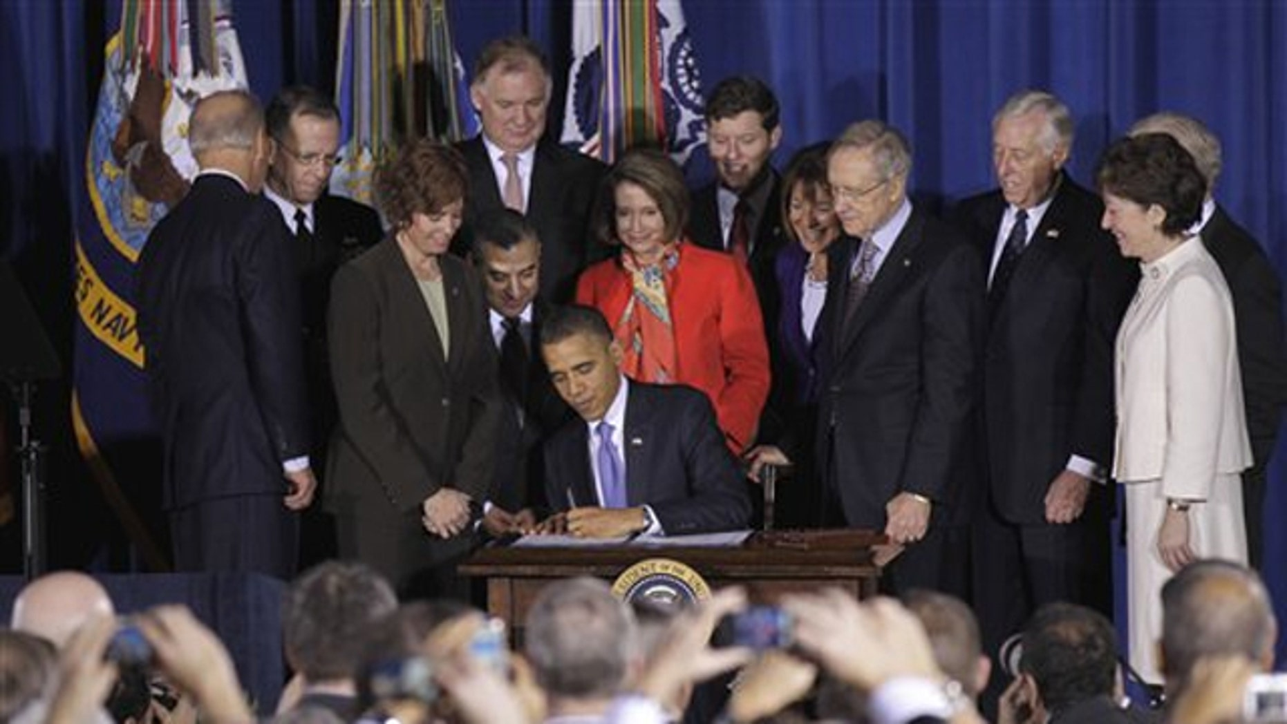 President Obama signs the 'don't ask, don't tell' repeal Dec. 22 at the Interior Department in Washington.
