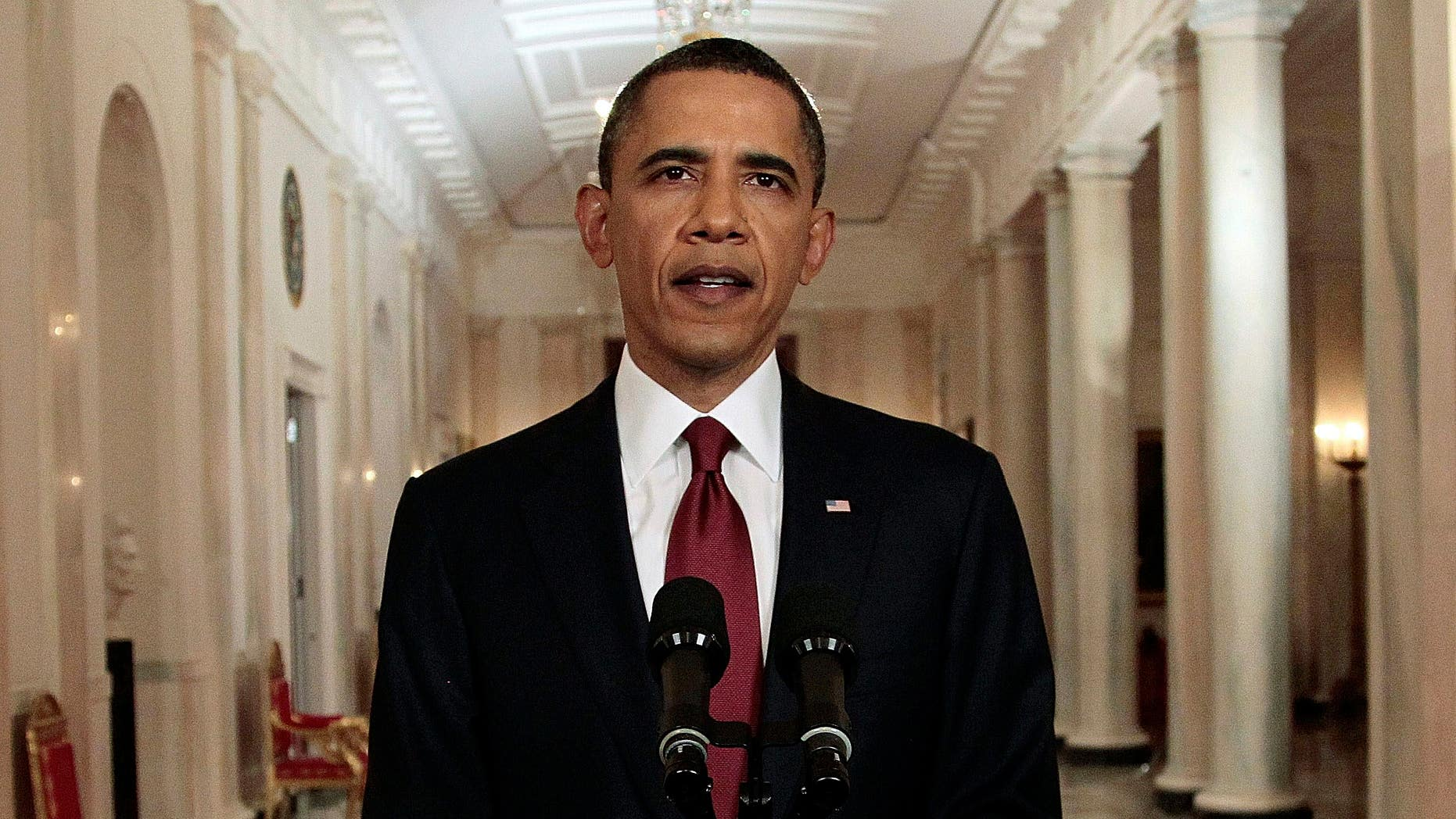 FILE: This May 1, 2011, photo of President Obama shows a him reading a portion of a speech to press photographers, after making a televised address to the entire country on the death of Usama bin Laden, from the East Room of White House.