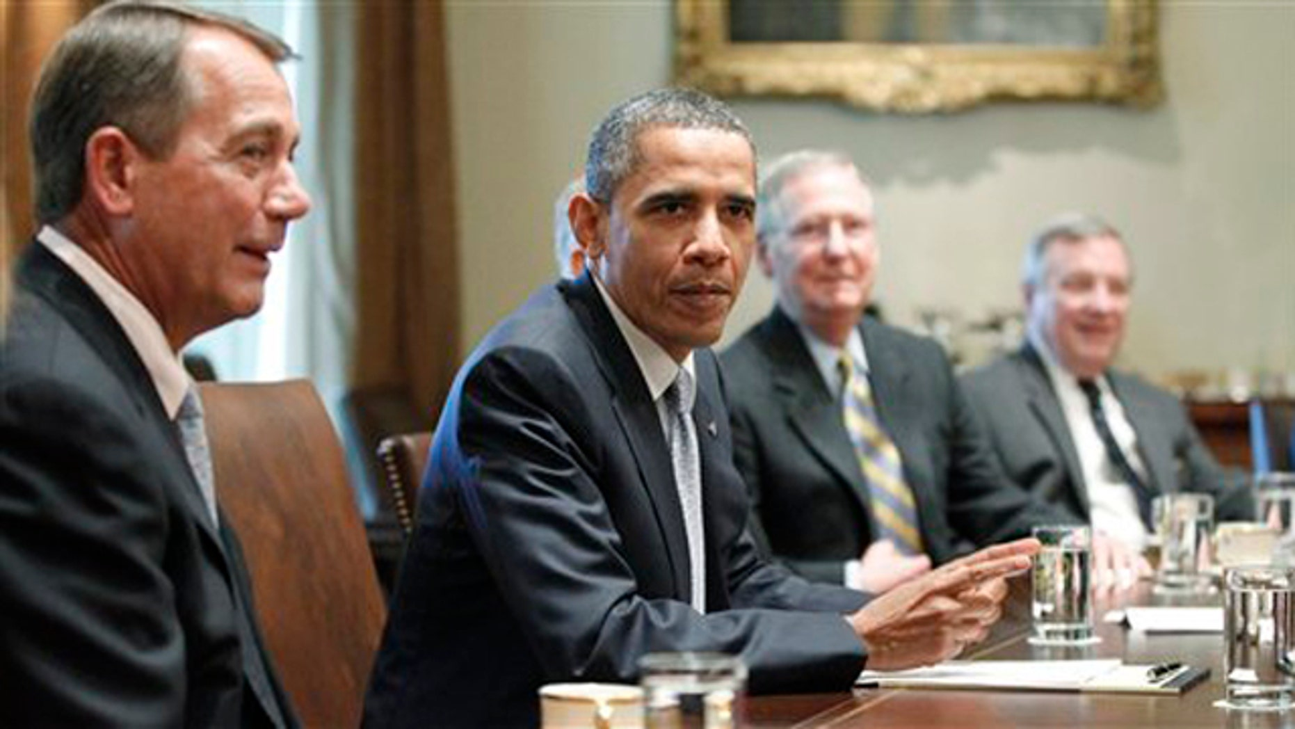 President Obama sits with House Speaker John Boehner, Senate Minority Leader Mitch McConnell and Sen. Dick Durbin as he meets regarding the debt ceiling in the Cabinet Room of the White House July 13.