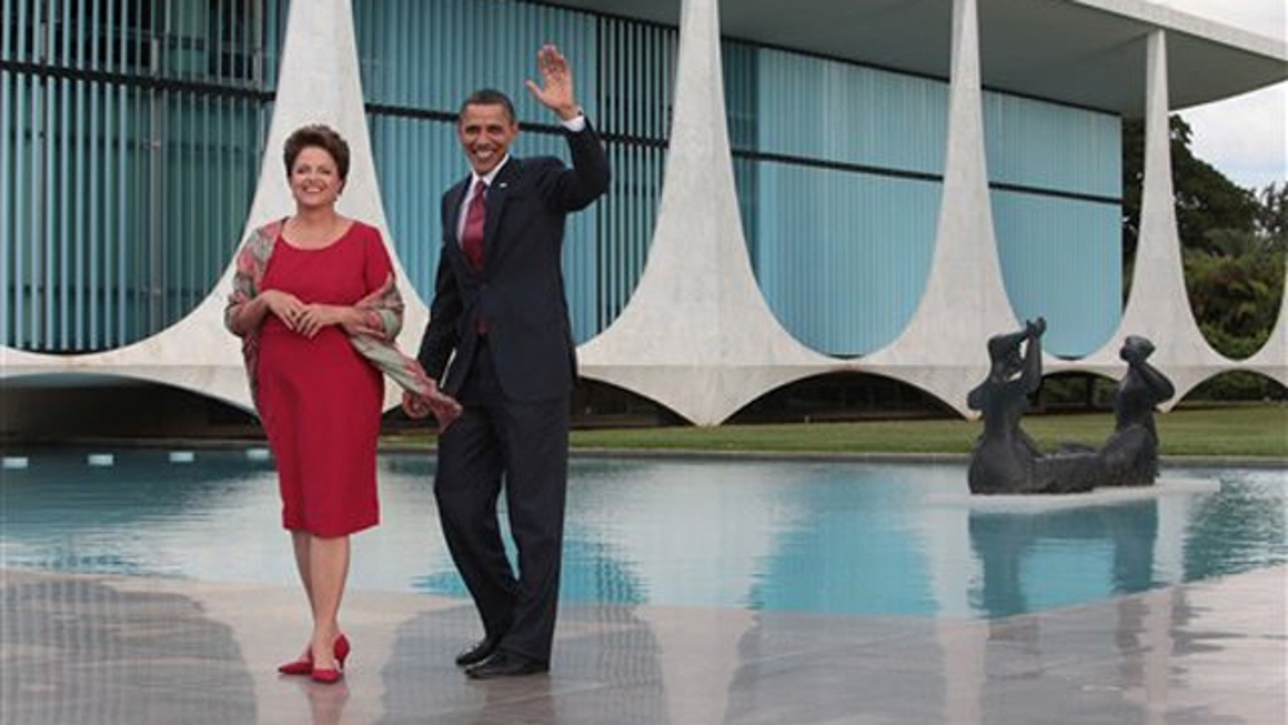 Saturday: President Obama, accompanied by Brazil's President Dilma Rousseff, waves as he arrives in Brasilia, Brazil.