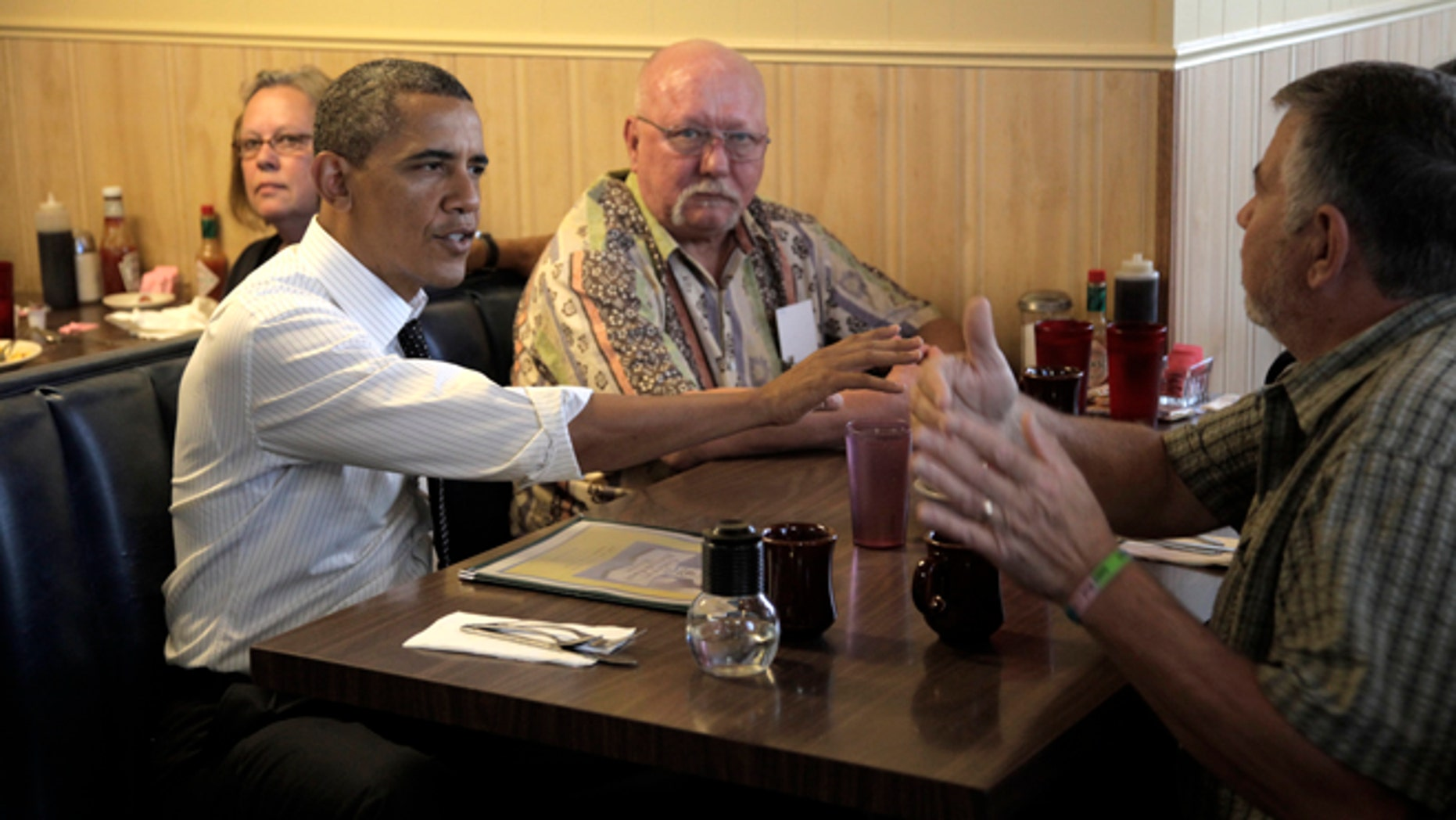 July 24, 2012: President Obama talks with veterans at the Gateway Breakfast House in Portland, Ore.