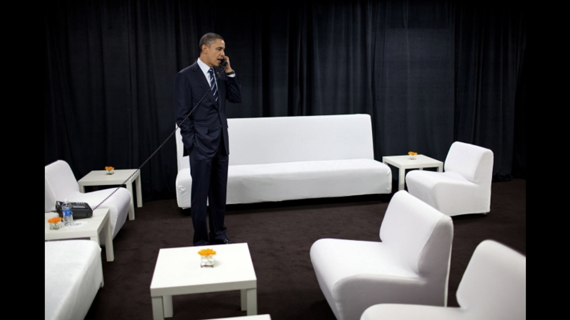 President Barack Obama talks on the phone with National Security Advisor Tom Donilon about developments in the Middle East, backstage at Intel Corporation in Hillsboro, Ore., Feb. 18, 2011. (Official White House Photo by Pete Souza)