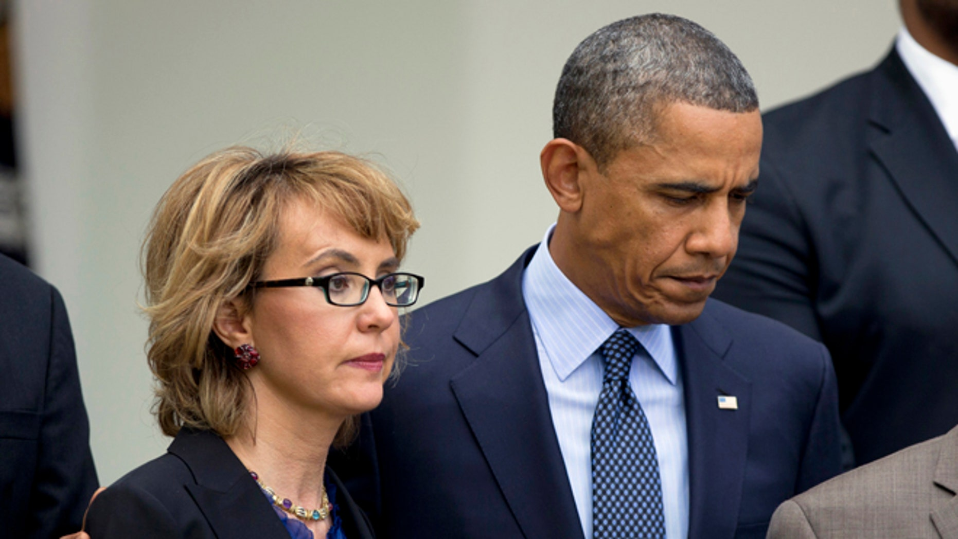 April 17, 2013: President Obama puts his arm around former Arizona Rep. Gabrielle Giffords before speaking in the Rose Garden at the White House in Washington about measures to reduce gun violence.