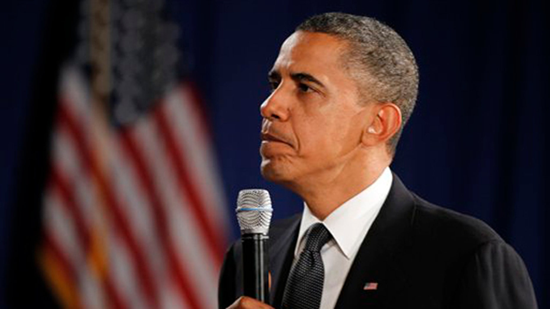 President Obama listens to a question at George Washington University in Washington Oct. 12.