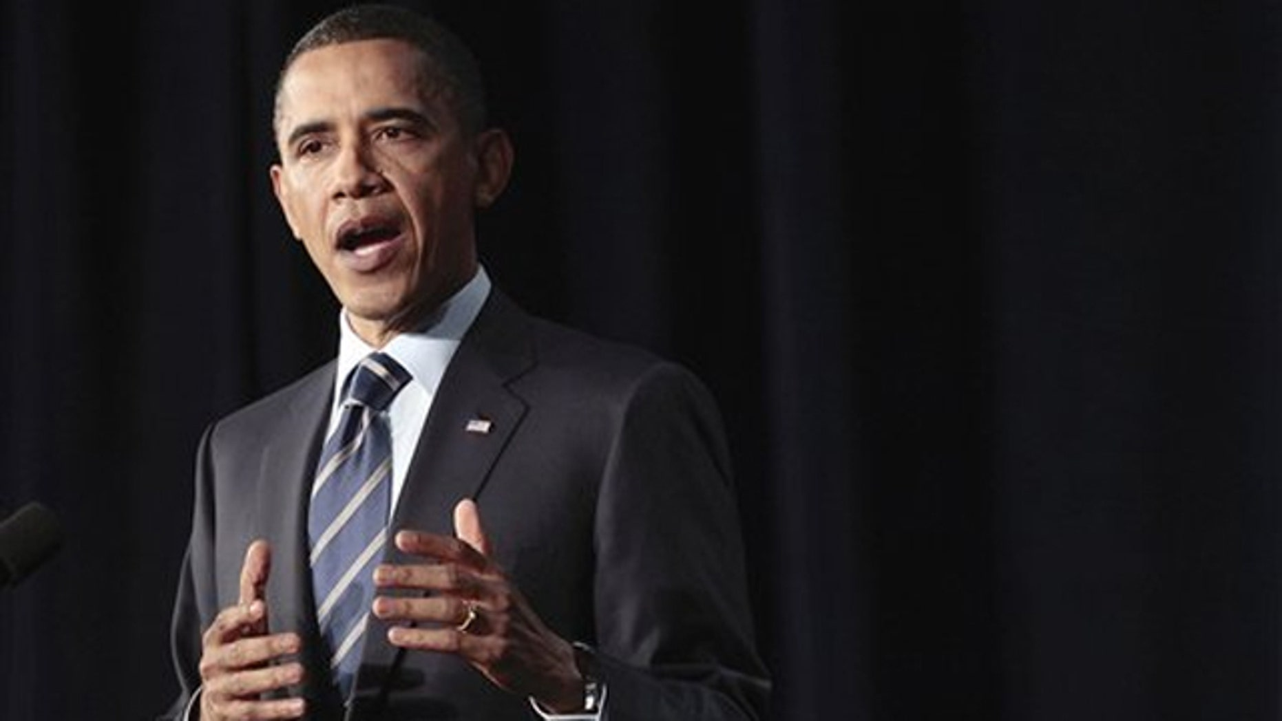 President Obama outlines his fiscal policy during an address at George Washington University in Washington April 13.