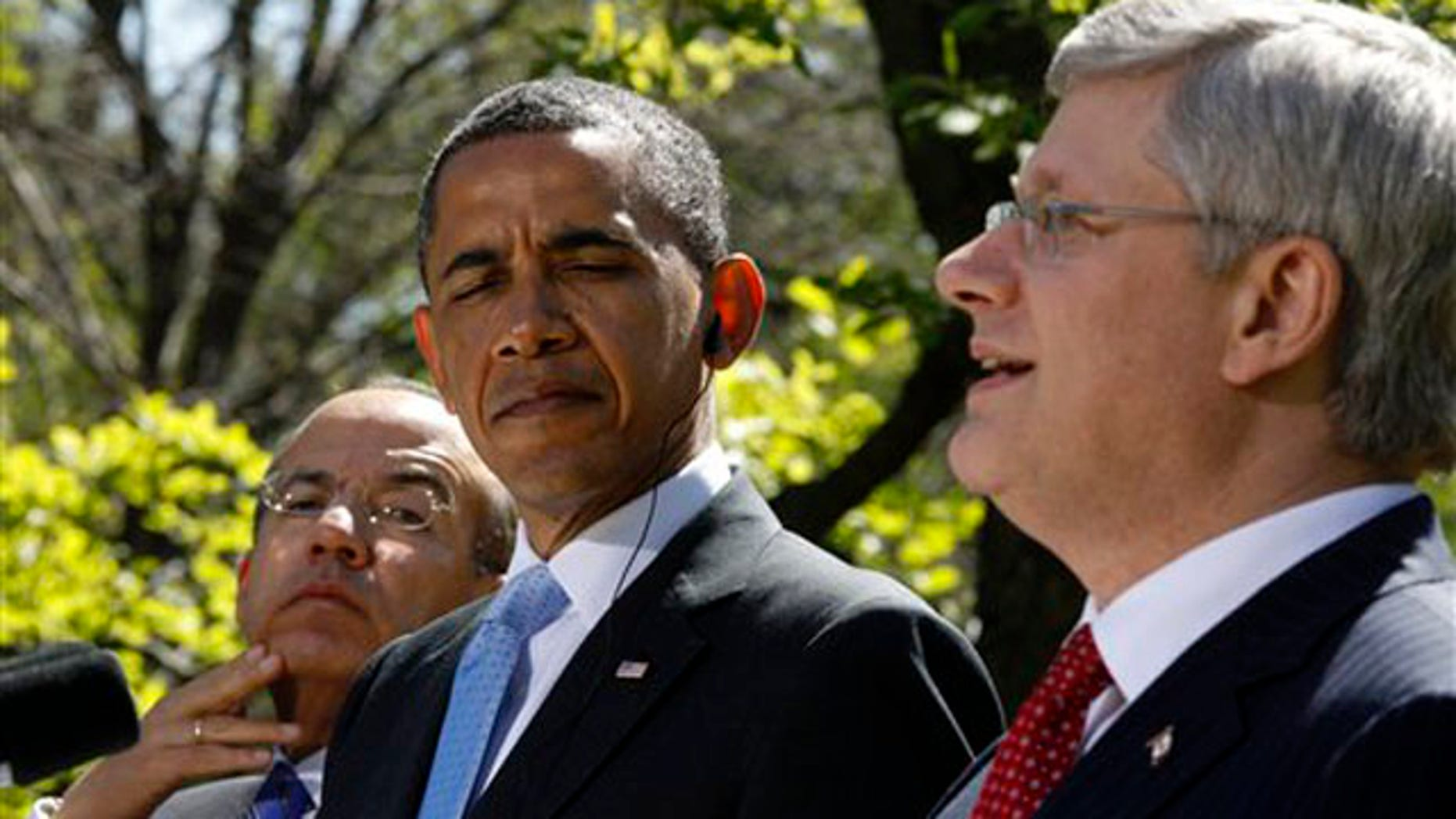 April 2, 2012: President Obama, Mexico's President Felipe Calderon, left, and Canada's Prime Minister Stephen Harper take part in a joint news conference in the Rose Garden.