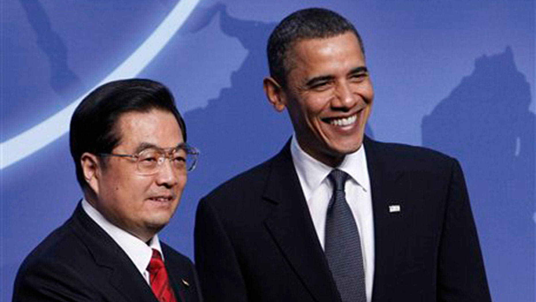 President Obama greets Chinese President Hu Jintao at the Nuclear Security Summit in Washington April 12. (AP Photo)