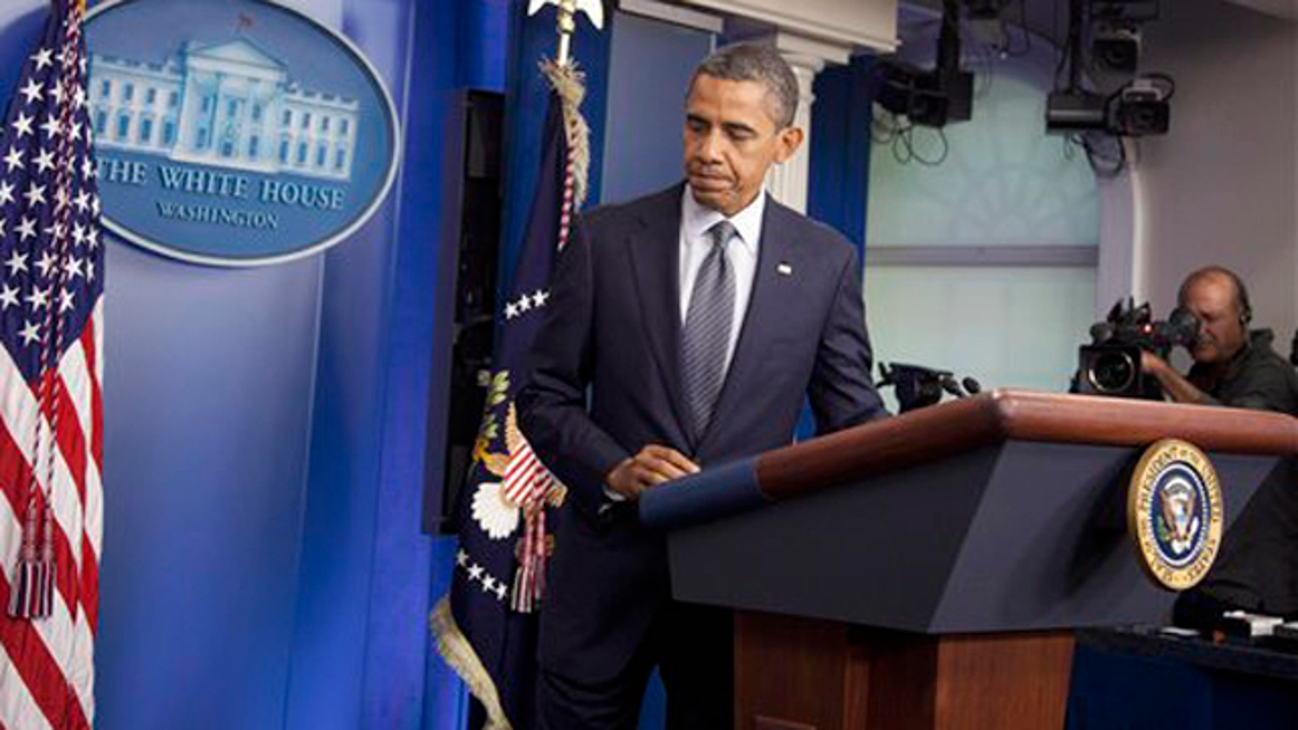 Oct. 21, 2011: President Obama leaves after speaking in the briefing room of the White House.