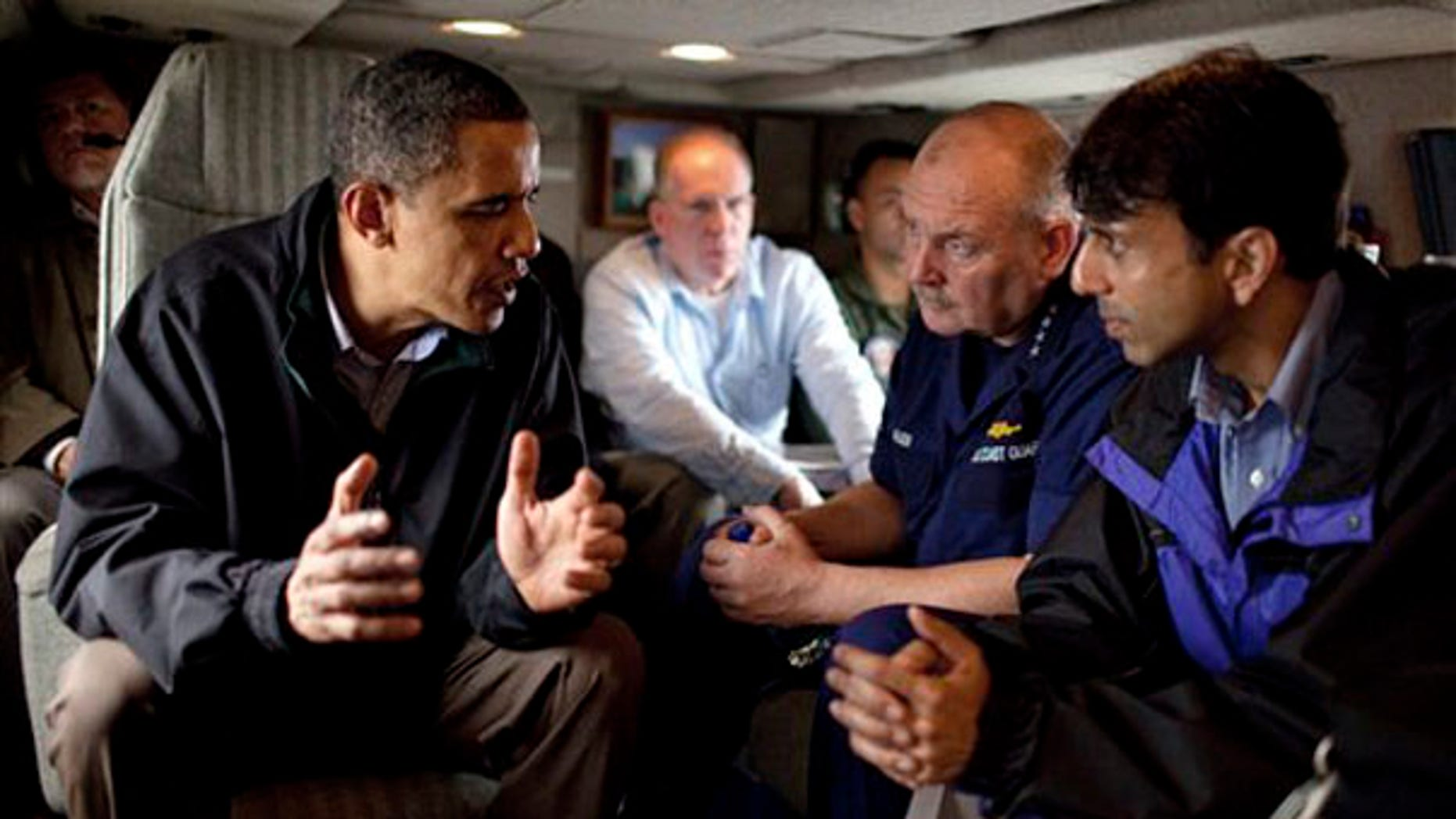 In this photo released by the White House, President Obama talks with U.S. Coast Guard Commandant Adm. Thad Allen, second right, and Louisiana Gov. Bobby Jindal aboard Marine One as they fly along the coastline from Venice, La., to New Orleans on May 2. (AP Photo)
