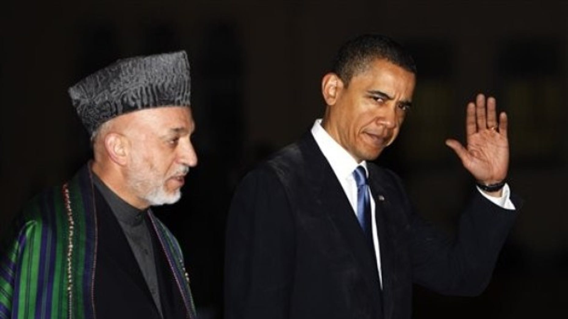 March 28, 2010: President Obama meets with Afghan President Hamid Karzai, left, at the presidential palace in Kabul, Afghanistan.
