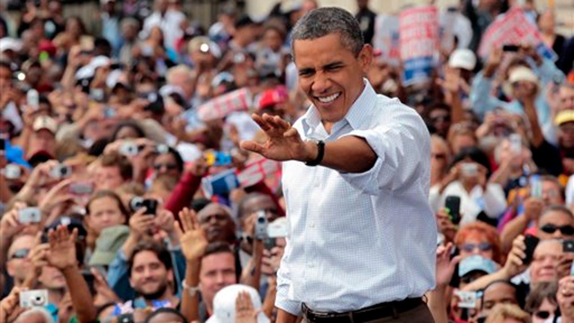 Sept. 5: President Barack Obama waves to supporters during a Labor Day speech at Detroit's Renaissance Center, headquarters of General Motors, in Detroit, Mich.