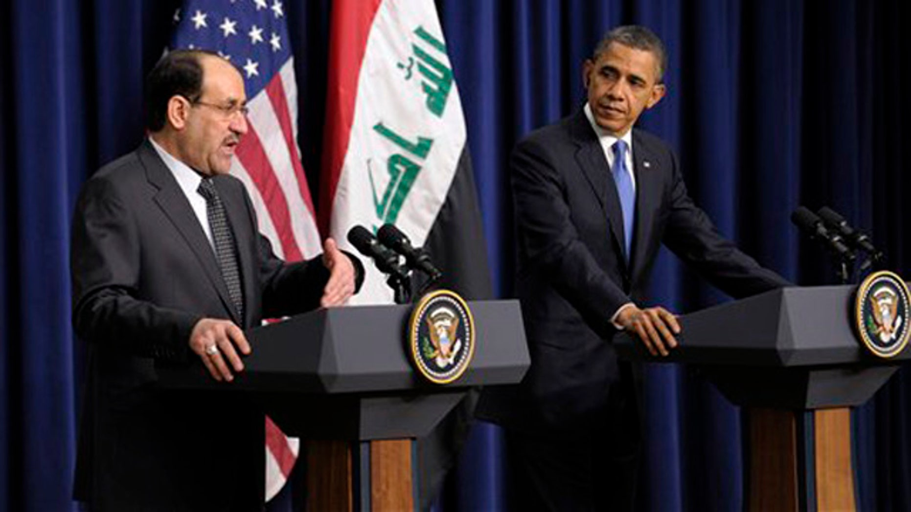 Dec. 12, 2011: President Obama listens as Iraq's Prime Minister Nouri al-Maliki speaks during a news conference at the White House in Washington.