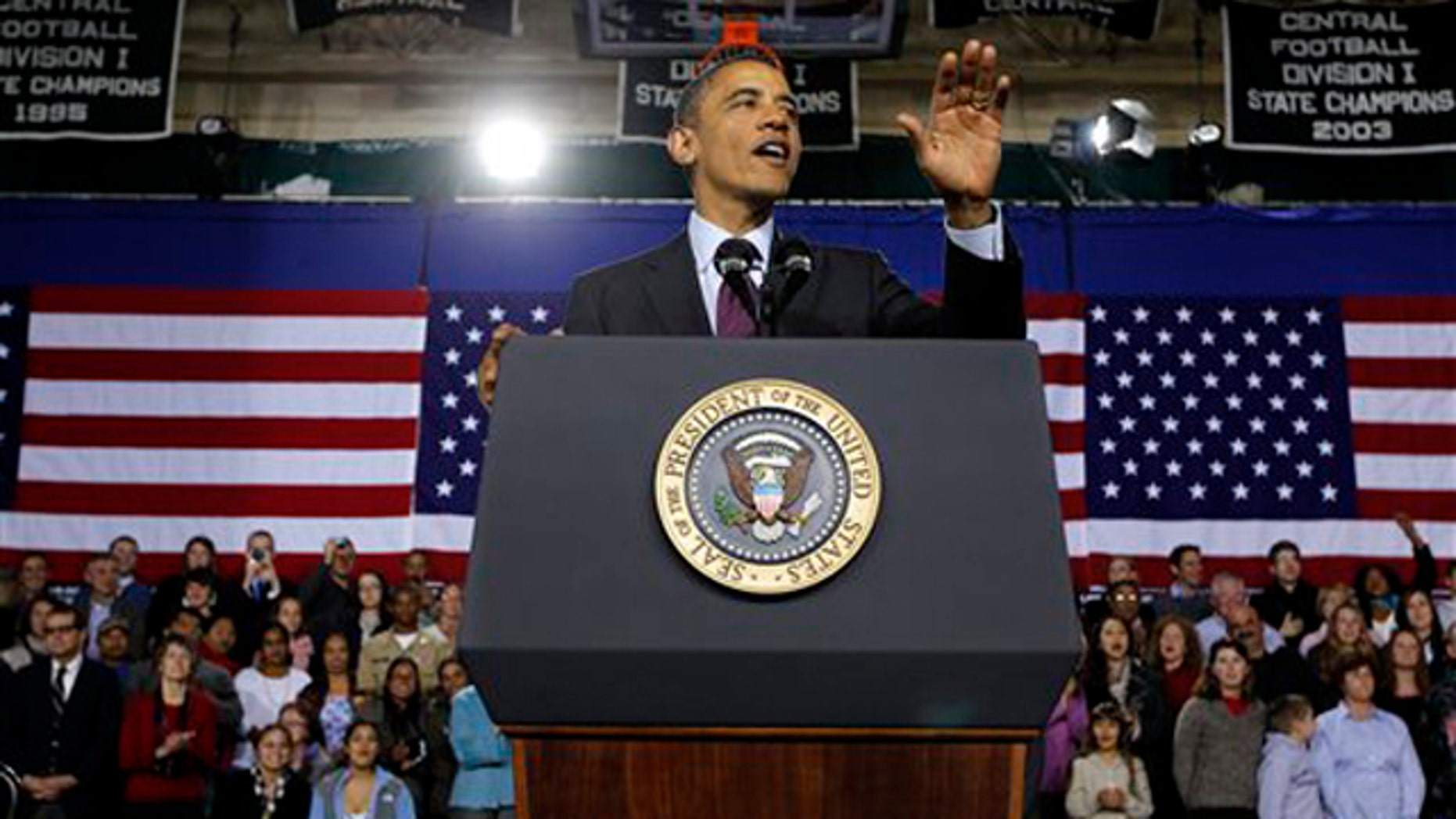 Nov. 22, 2011: President Obama gestures during a speech at Manchester High School Central in Manchester, N.H.