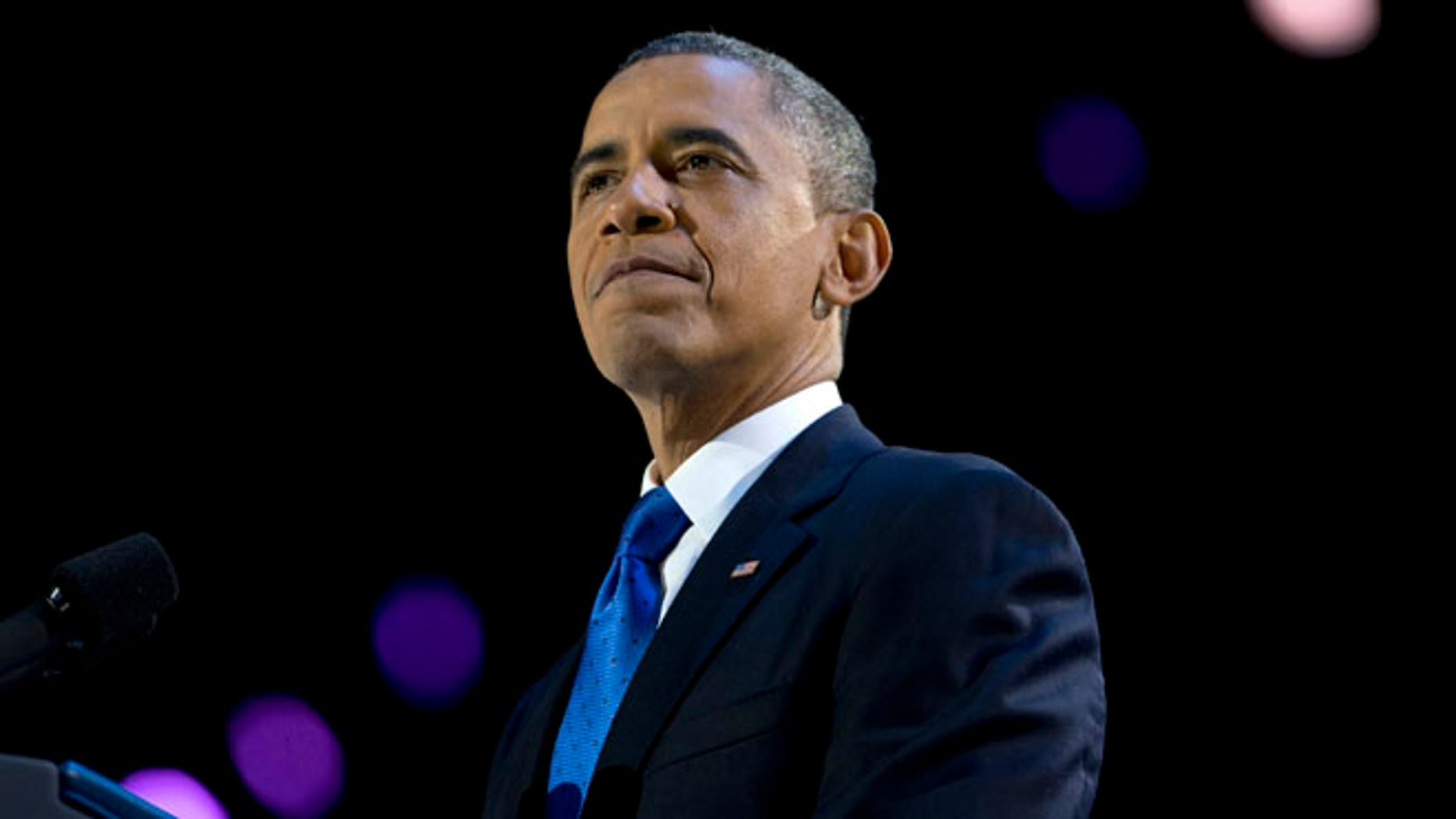 Nov. 7, 2012: President Obama pauses as he speaks at the election night party at McCormick Place in Chicago.