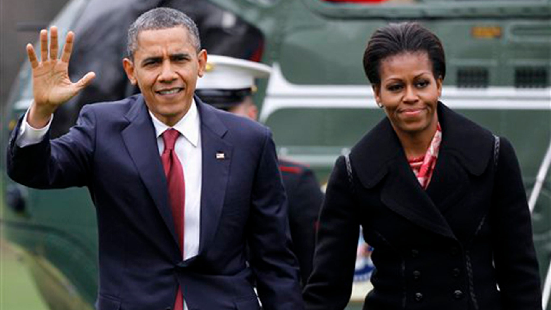 Dec. 14, 2011: President Obama and first lady Michelle Obama arrive on the South Lawn of the White House in Washington.