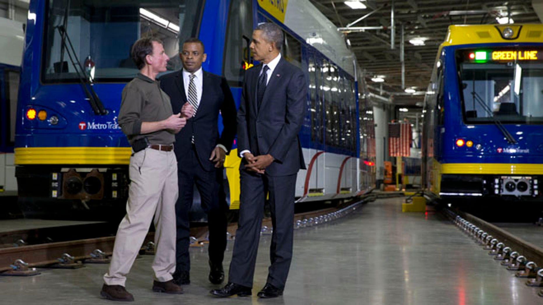 Feb. 26, 2014: Mark Fuhrmann, New Start Program Director of Metro Transit, left, talks with President Obama and Transportation Secretary Anthony Foxx, during a tour of the Metro Transit Light Rail Operations and Maintenance Facility in St. Paul, Minn.