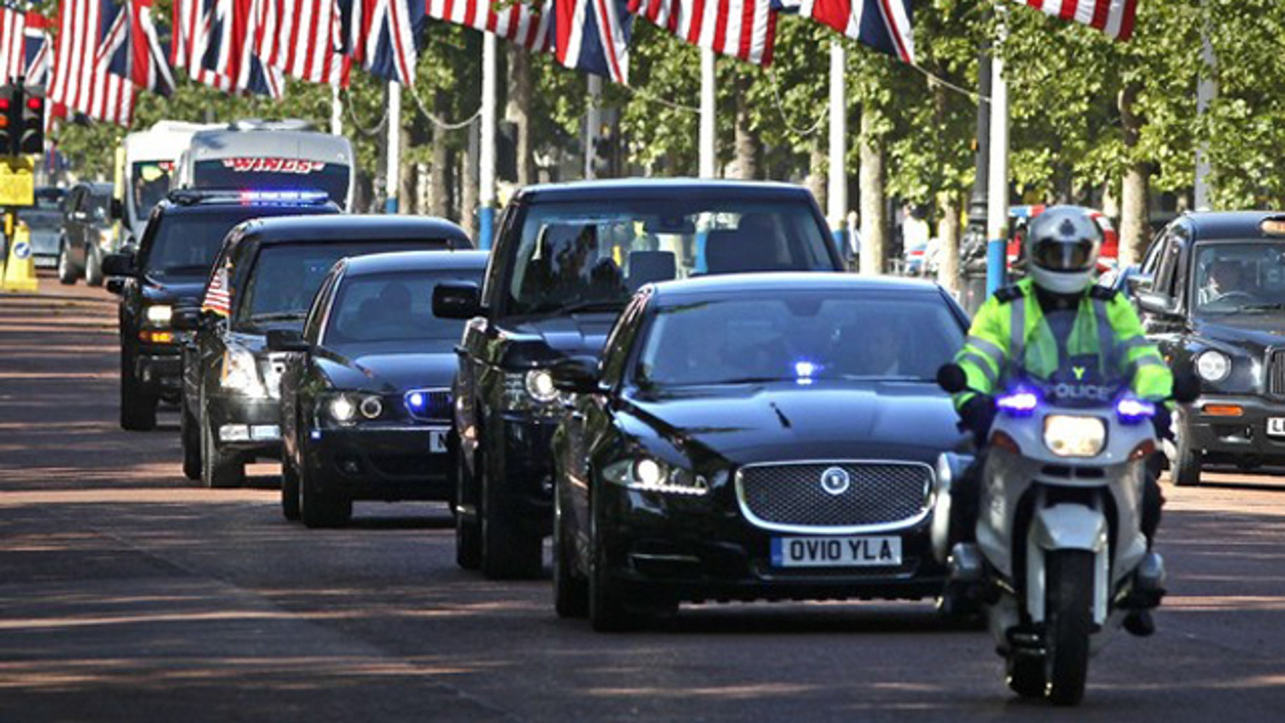 President Obama's motorcade travels along the Mall as it leaves Buckingham Palace to go to Downing Street in central London May 25.