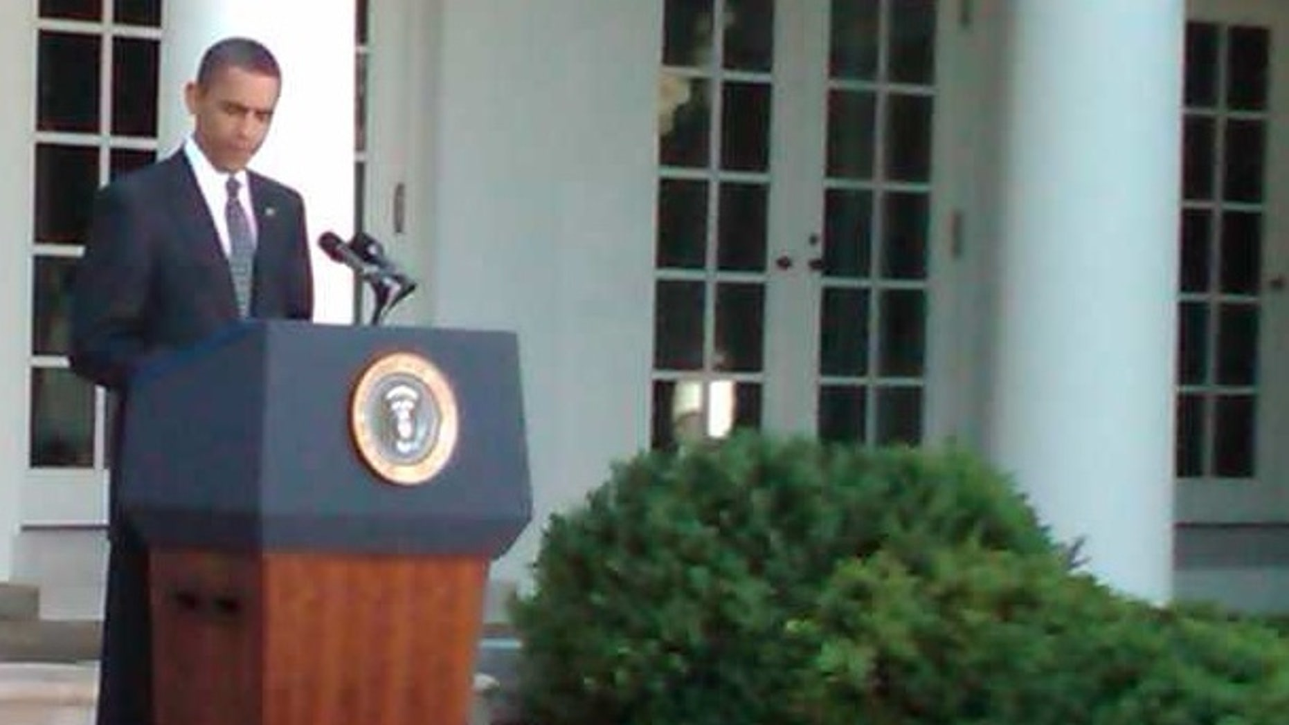 A small rodent (lower right corner) scurries in front of President Obama during remarks about Wall Street reform.        Fox Photo by Bryan Cole