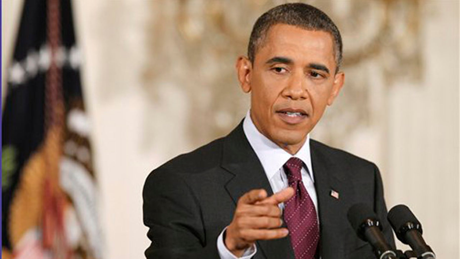 President Obama gestures during a news conference in the East Room of the White House in Washington June 29.