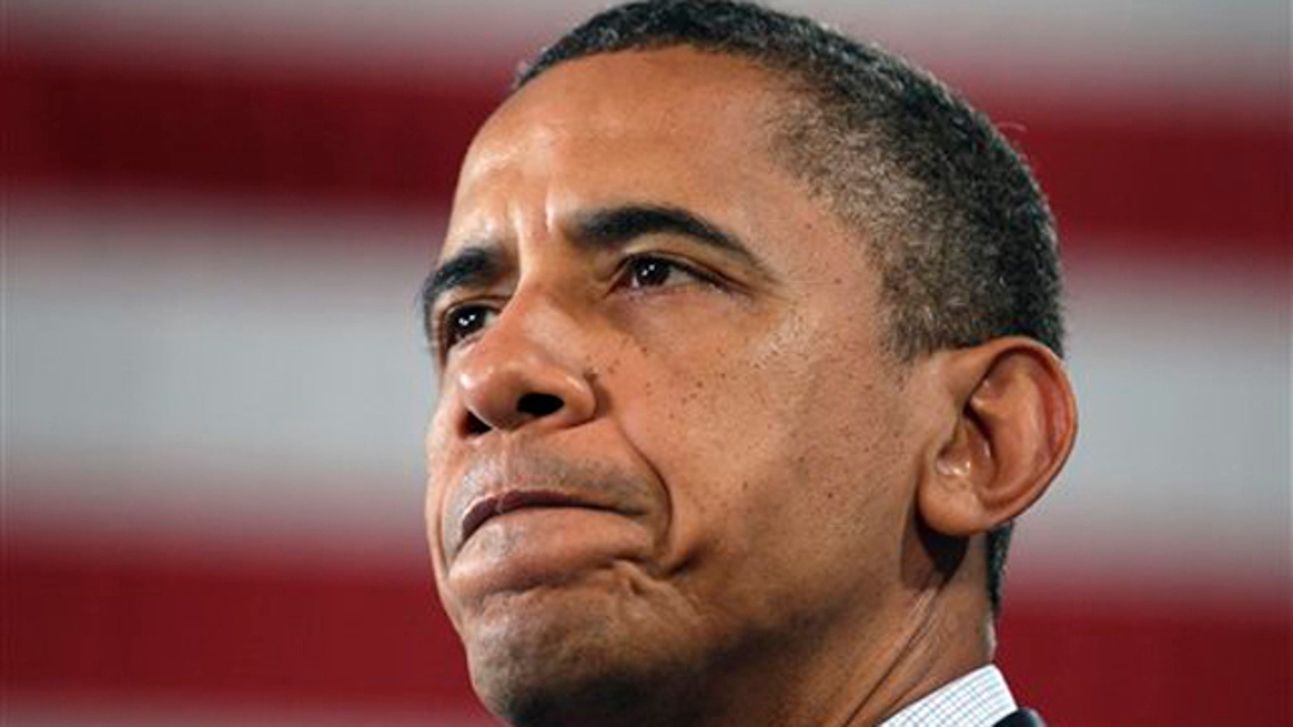 Tuesday: President Obama pauses as he speaks during a Rural Economic Forum in Peosta, Iowa.