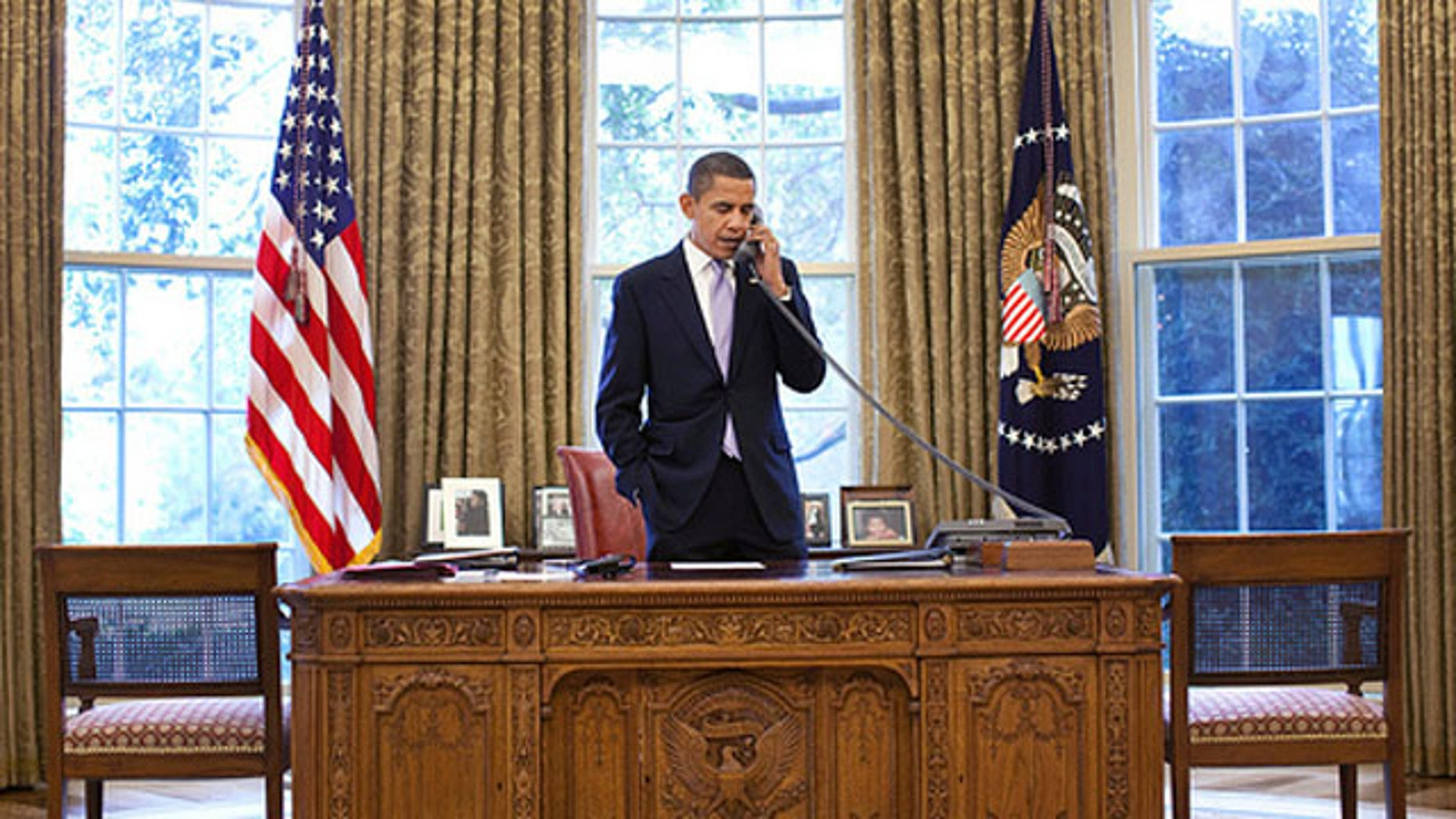 President Obama talks with Hamid Karzai about the Afghanistan election on a phone call from the Oval Office Nov. 2. (White House Photo)