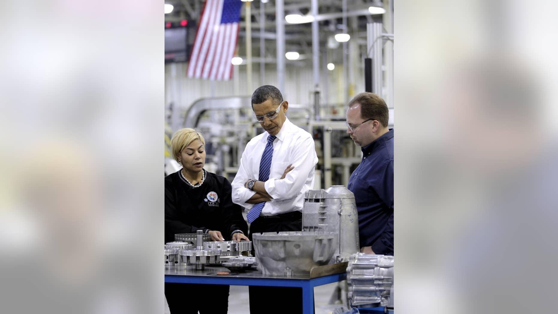President Barack Obama tours Chrysler's Indiana Transmission Plant II in Kokomo, Ind., Tuesday, Nov. 23, 2010. (AP Photo/J. Scott Applewhite)