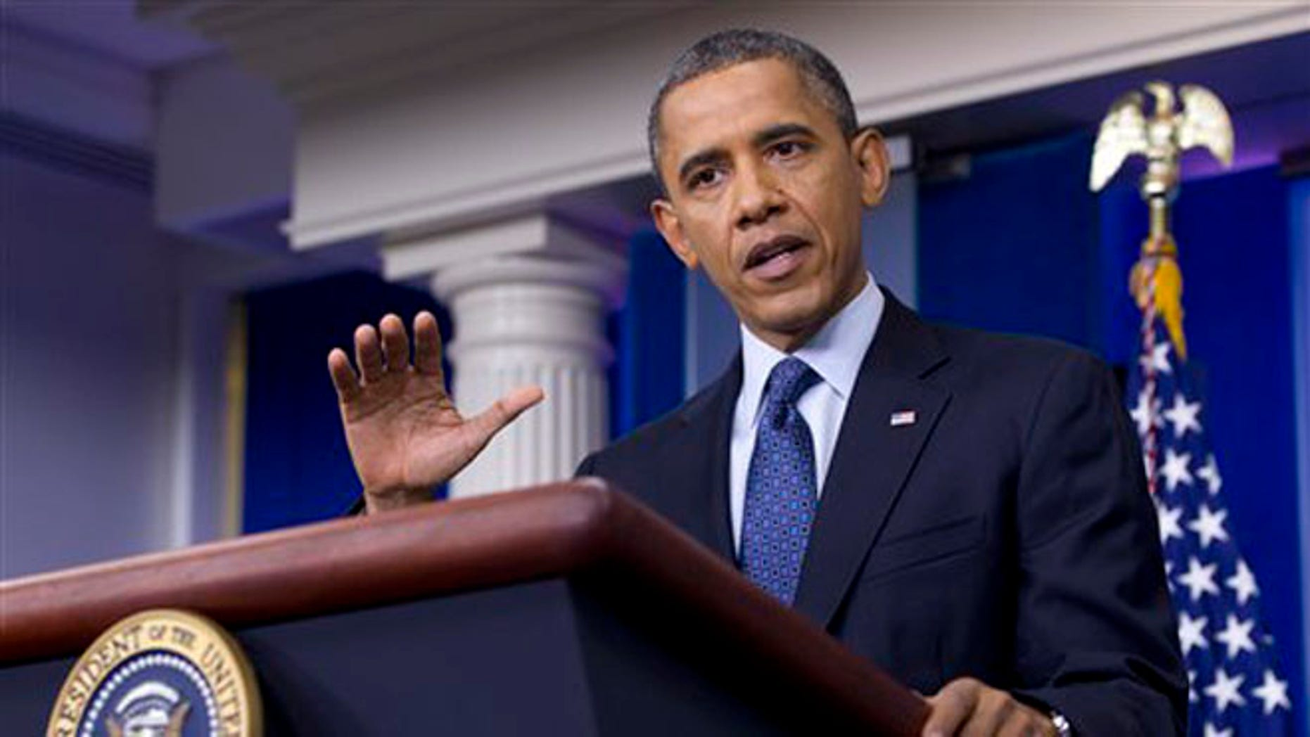 FILE: June 8, 2012: President Obama talks at a press conference inside the White House Briefing Room, in Washington.