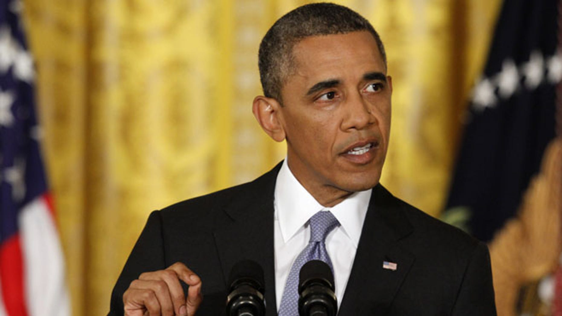 FILE: Aug. 9, 2013: President Obama speaks during a news conference in the East Room of the White House in Washington.