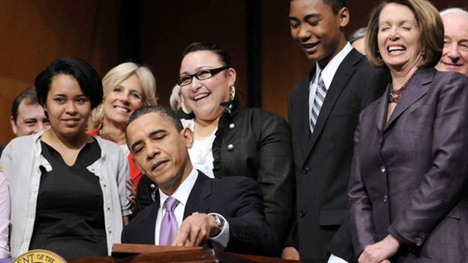 President Obama signs the Health Care and Education Reconciliation Act into law at Northern Virginia Community College in Alexandria, Va., March 30. (Reuters Photo)