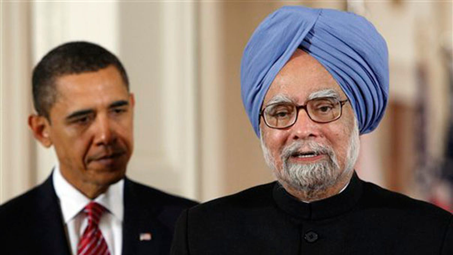 Tuesday: Prime Minister Manmohan Singh of India delivers his welcome address as President Obama listens during a state arrival ceremony in the East Room of the White House. (AP Photo)