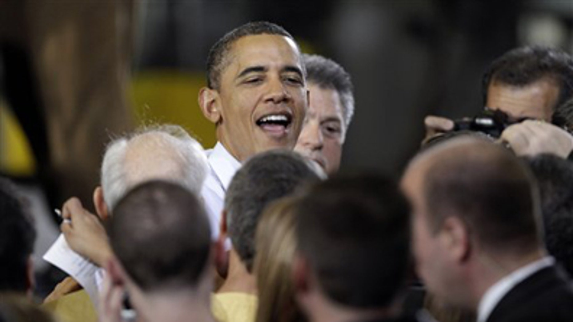Jan. 25, 2012: President Obama is greeted after speaking about manufacturing jobs, at the Conveyor Engineering & Manufacturing plant, in Cedar Rapids, Iowa.