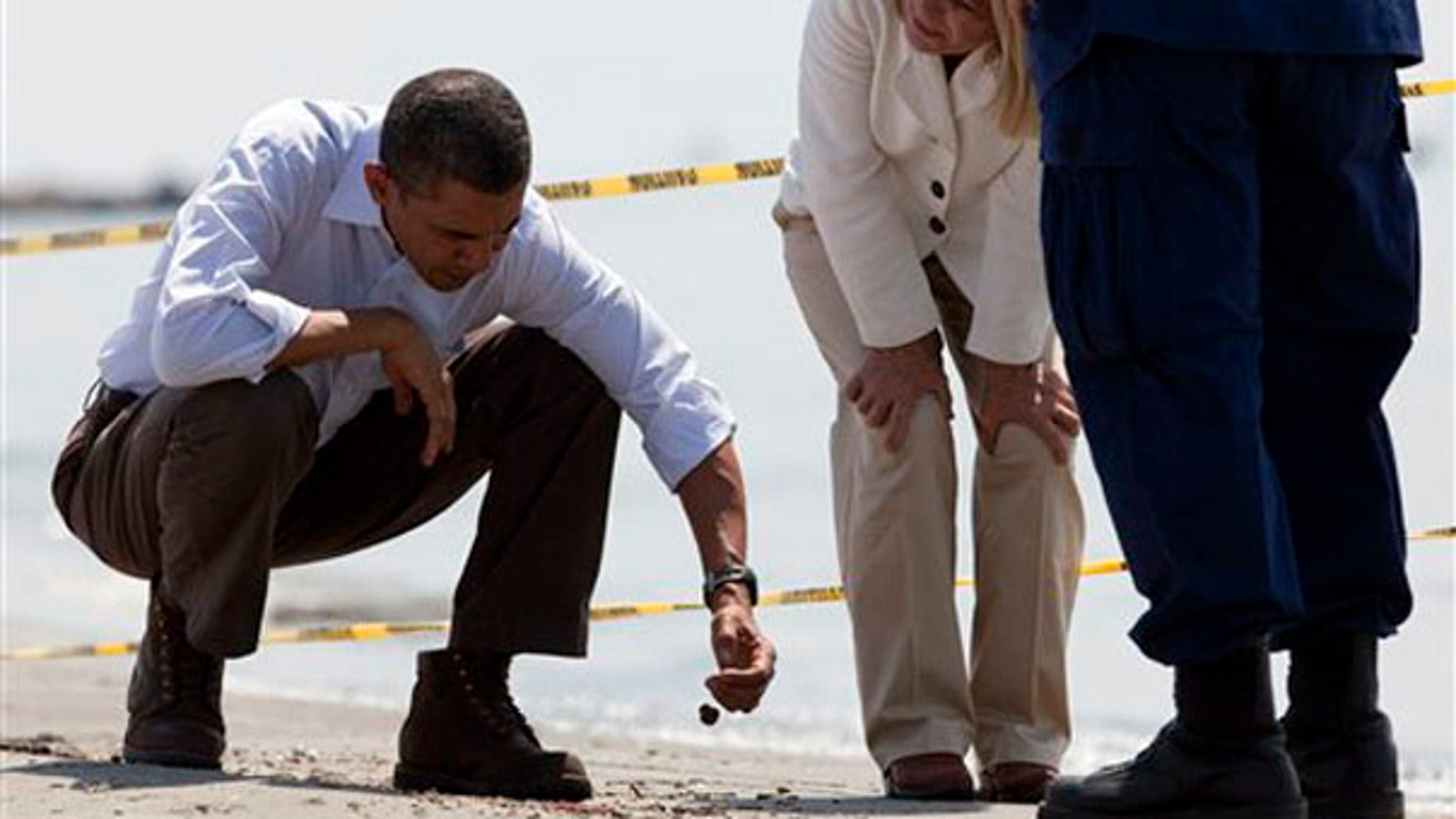 President Obama picks up a 'tar ball' during a tour of areas impacted by the Gulf Coast oil spill May 28 in Port Fourchon, La. (AP Photo)