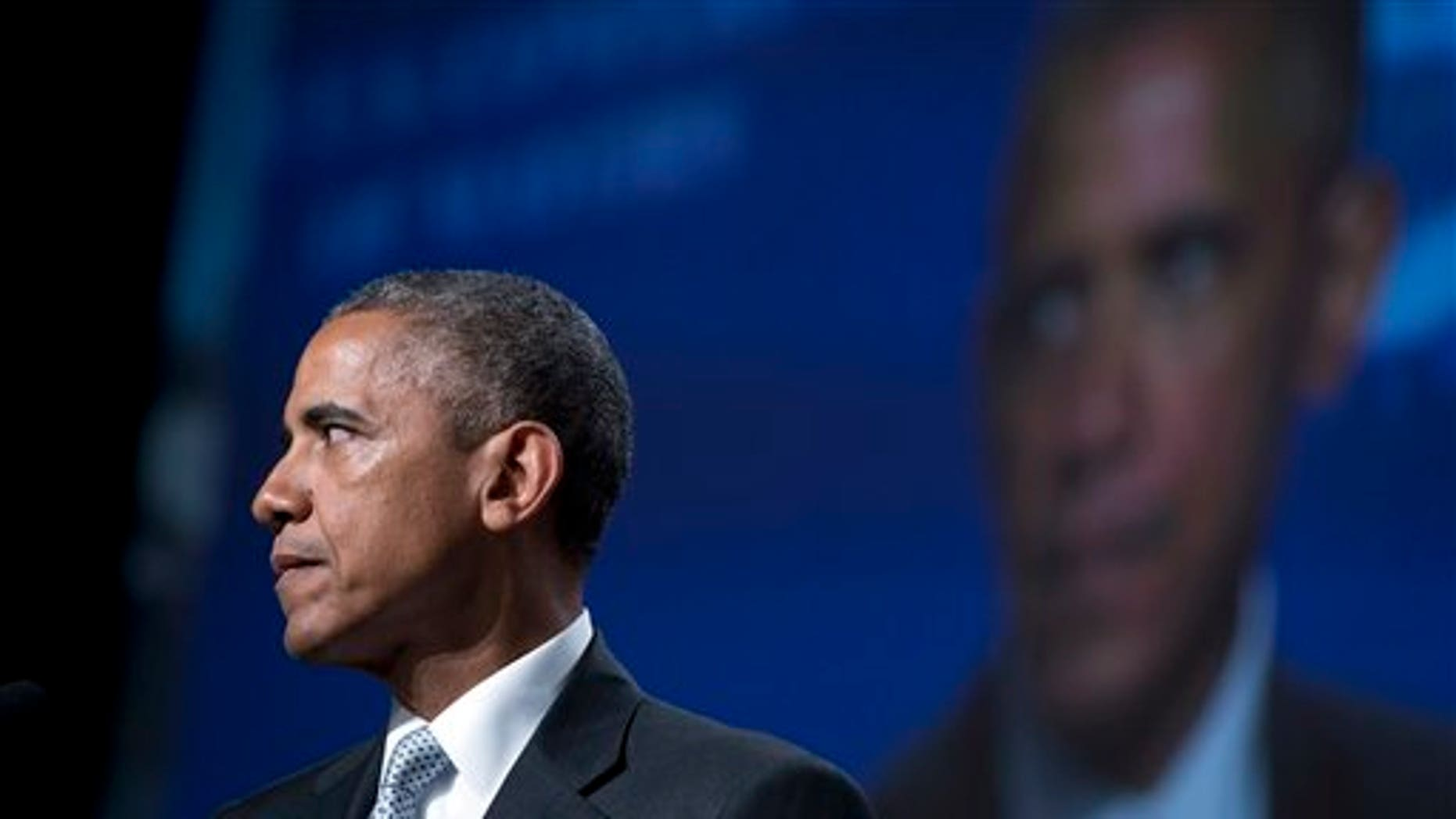 June 19: President Obama pauses as he speaks about gun violence at the Annual Meeting of the U.S. Conference of Mayors in San Francisco. (AP Photo/Carolyn Kaster)
