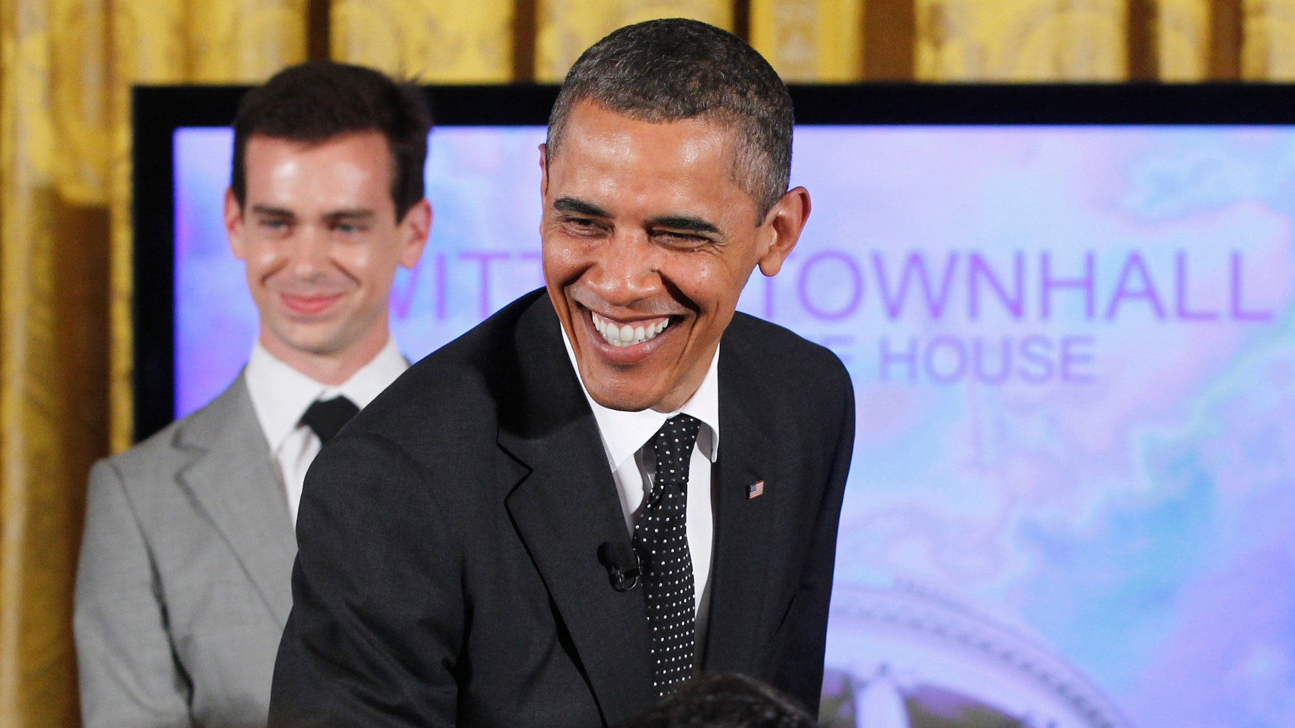 President Obama used a gun metaphor to describe debt talks with Republicans during a Twitter Town Hall in the East Room of the White House in Washington, Wednesday, July 6, 2011.