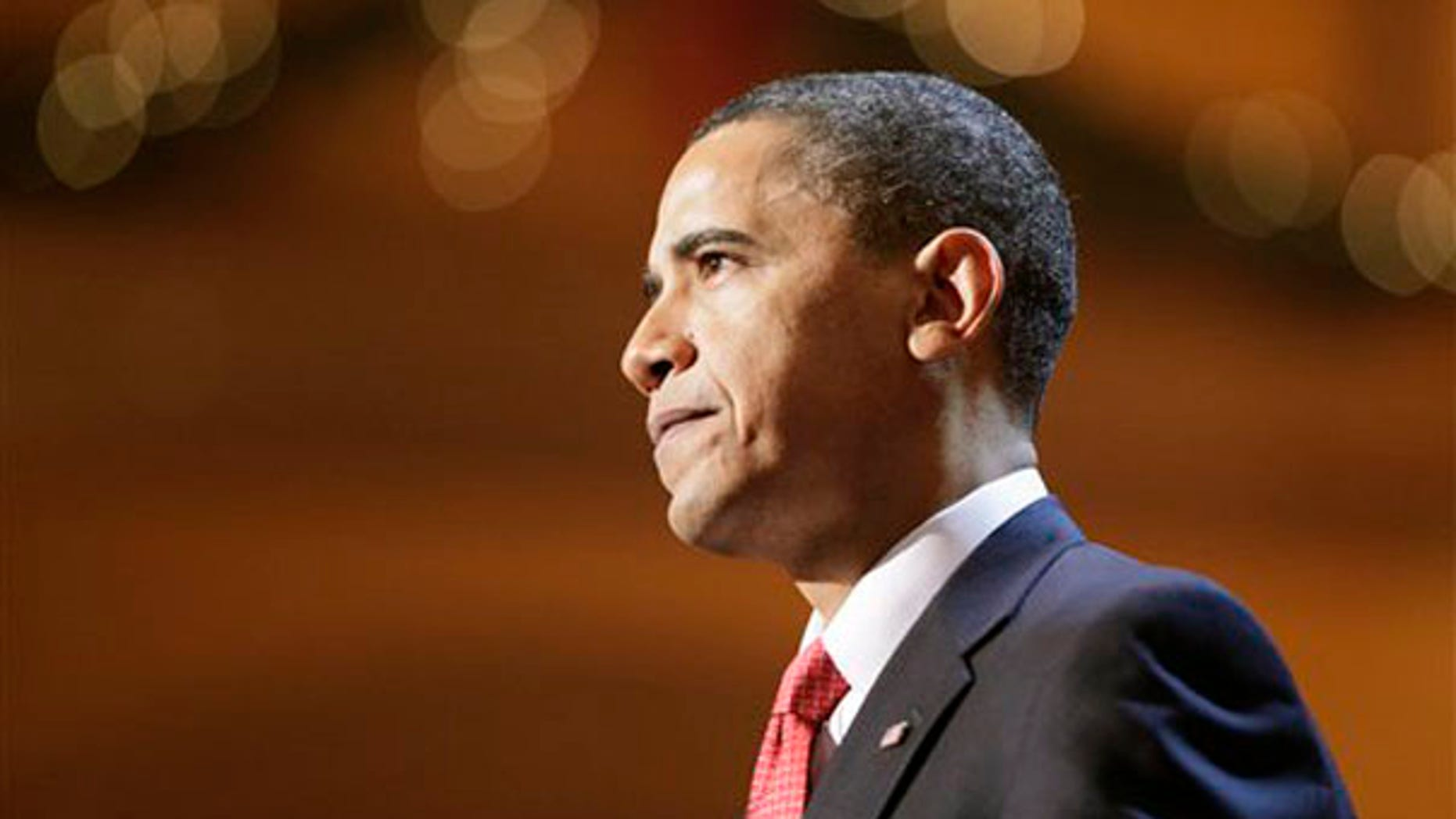 Sunday: President Obama speaks at a Christmas event held at the National Building Museum in Washington. (AP Photo)